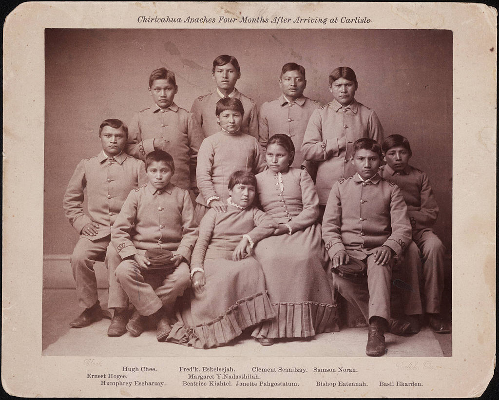 Photo portrait of Chiricahua Apache youths four months after arriving at the Carlisle Indian Industrial School in Carlisle, Pa.
