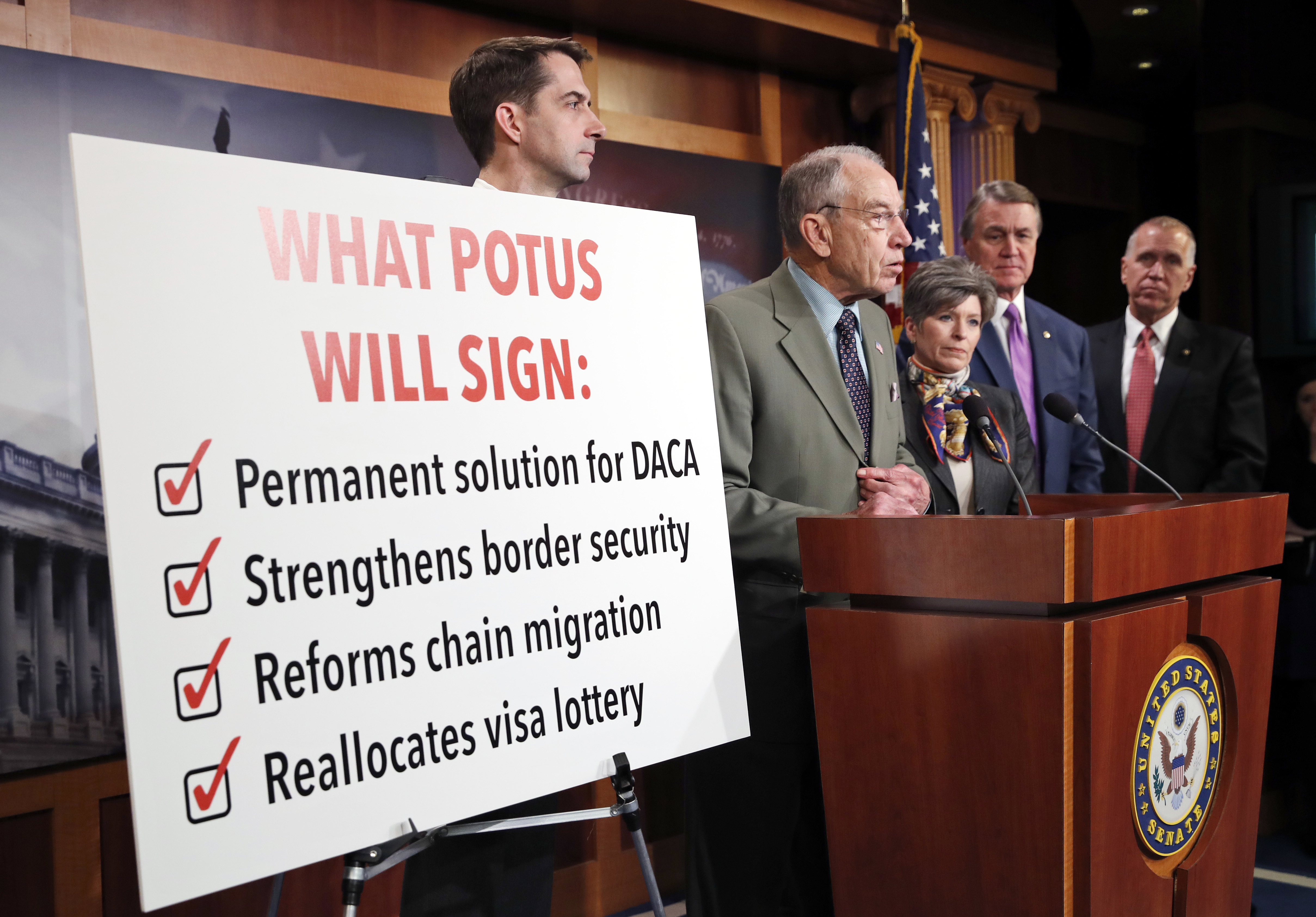 Sen. Chuck Grassley, R-Iowa, second from left, speaks accompanied by Sen. Tom Cotton, R-Ark., left, Sen. Joni Ernst, R-Iowa, Sen. David Perdue, R-Ga., and Sen. Thom Tillis, R-N.C., during a news conference about an immigration bill on Capitol Hill, F...