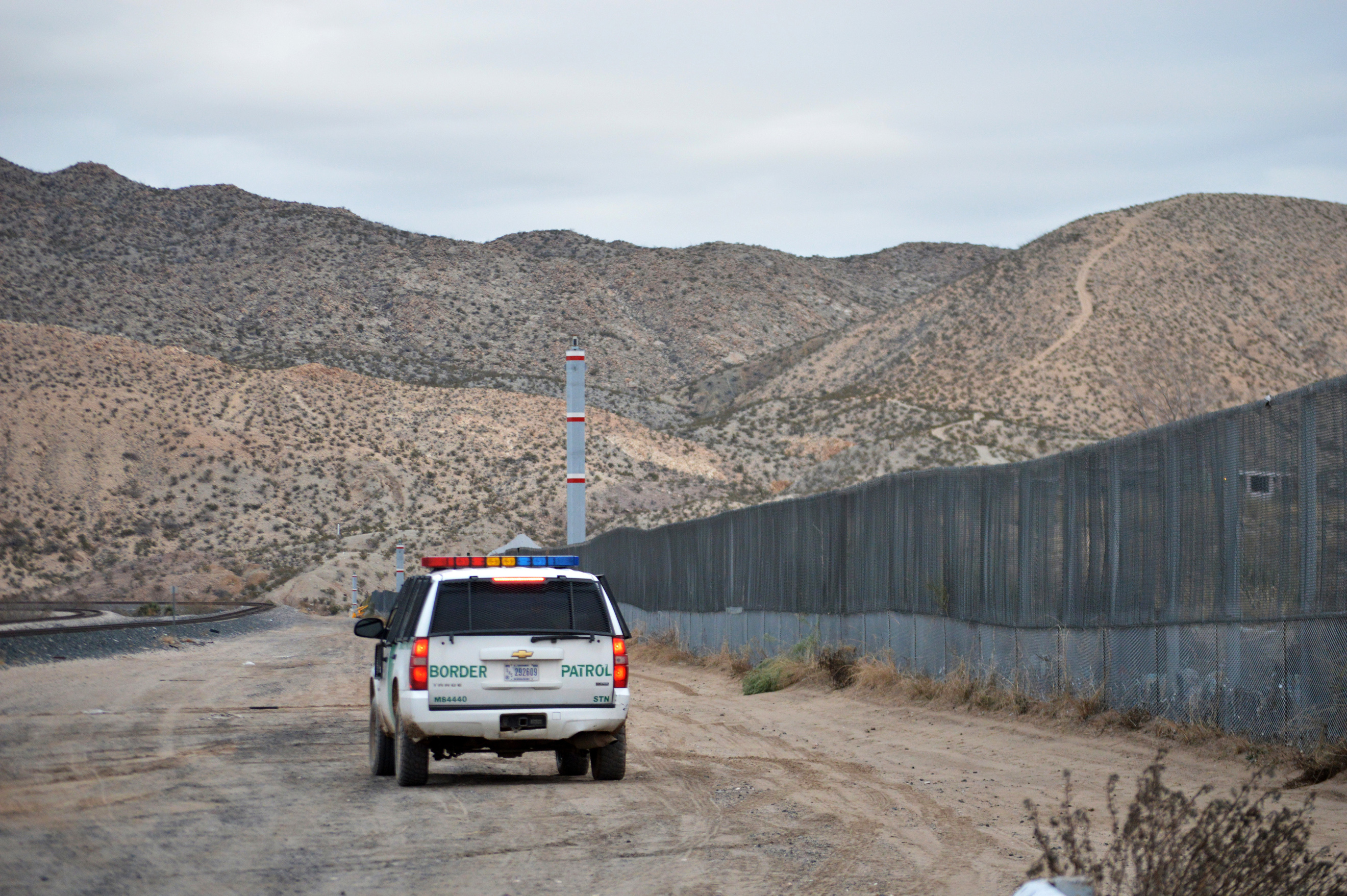 FILE - A U.S. Border Patrol agent patrols Sunland Park along the U.S.-Mexico border next to Ciudad Juarez, Jan. 4, 2016. A 7-year-old girl who had crossed the U.S.-Mexico border with her father, died after being taken into the custody of the U.S. Bor...