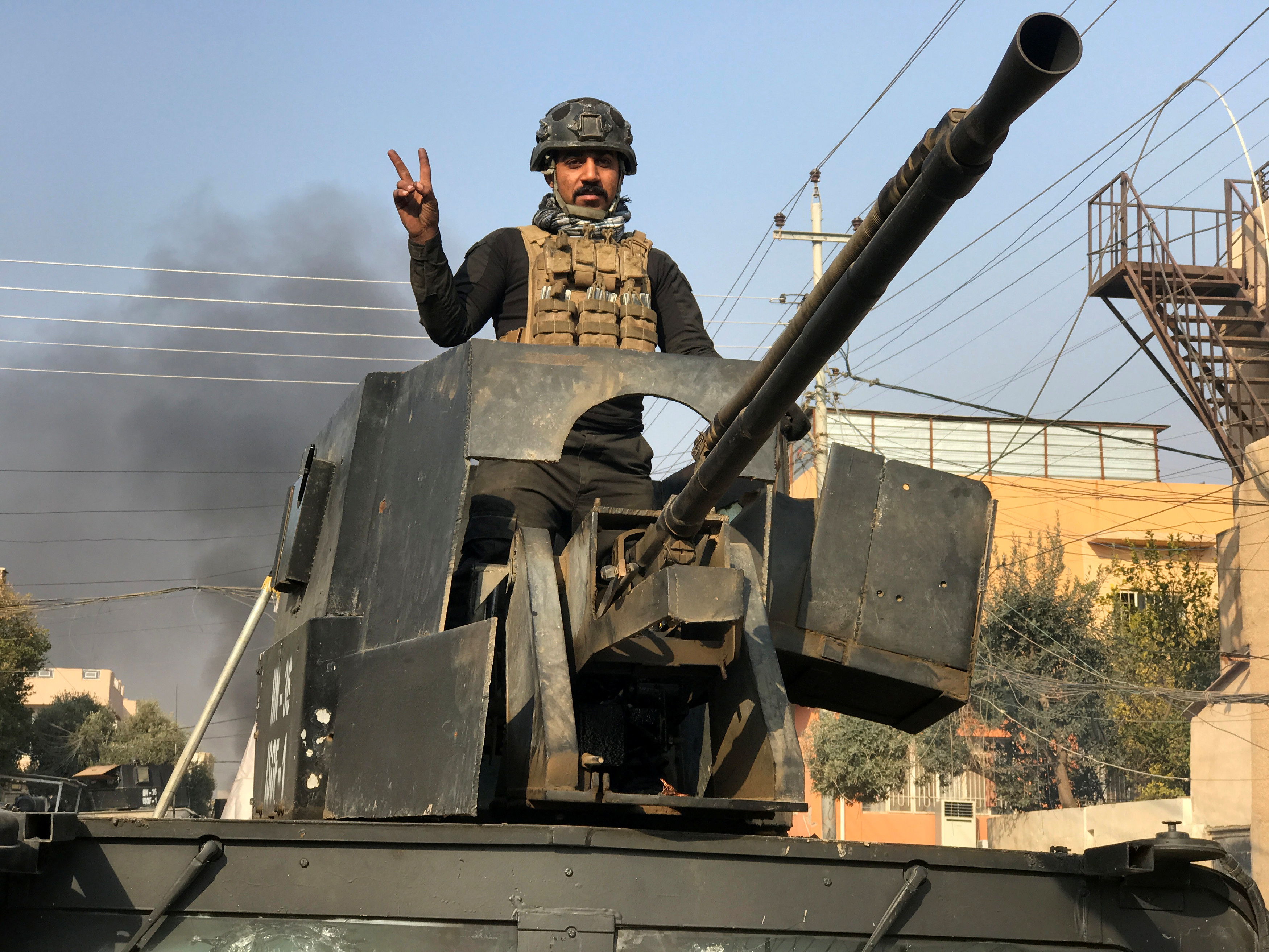 A member of Iraqi security forces stands in a military vehicle in Baladiyat district, east of Mosul during a fight with Islamic State, Jan. 9, 2017.