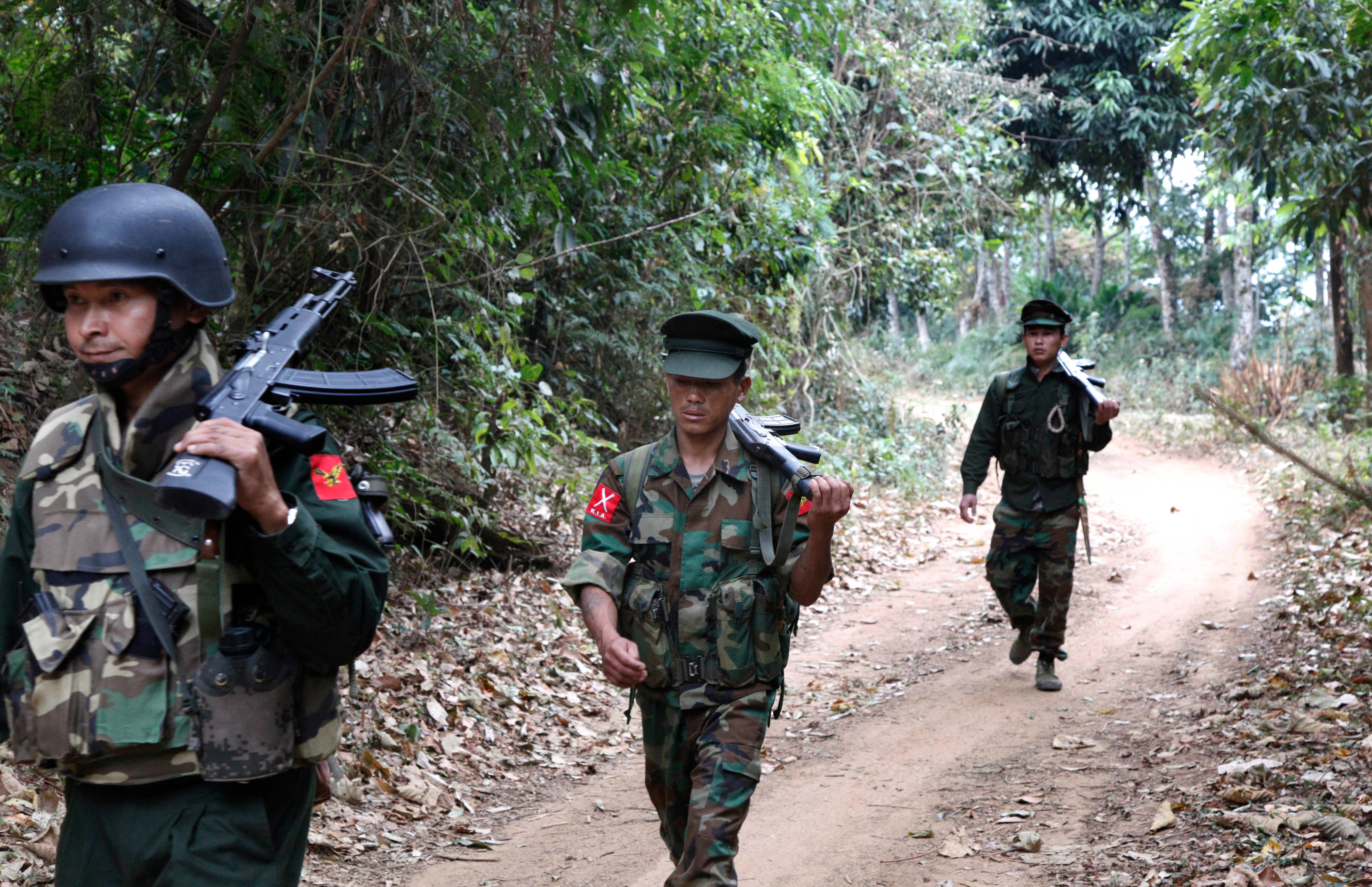 Kachin Independence Army fighters walk in a jungle path from Mu Du front line to Hpalap outpost in an area controlled by the Kachin rebels in northern Kachin state, Myanmar, March 17, 2018. While the world is focused on attacks on Myanmar's Rohingy...