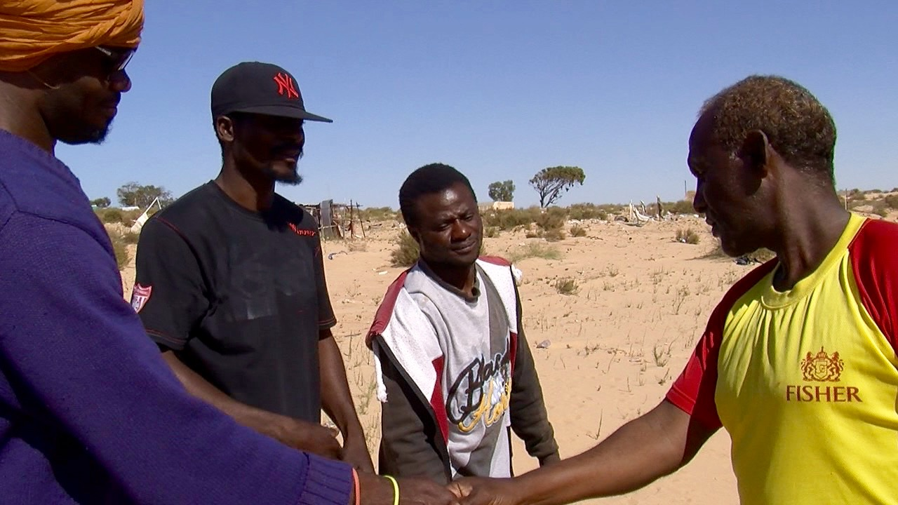 Tahir Abdoulaye (R) from Somalia is uncertain about his future.
