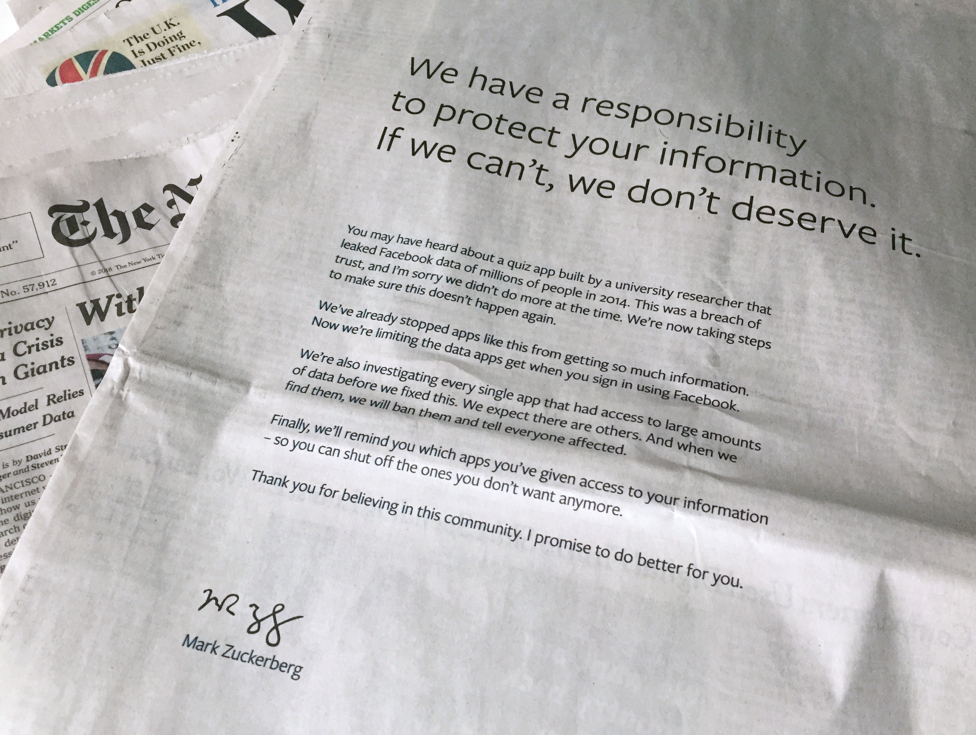 An advertisement in The New York Times is displayed on Sunday, March 25, 2018, in New York. Facebook's CEO apologized for the Cambridge Analytica scandal with ads in multiple U.S. and British newspapers Sunday.
