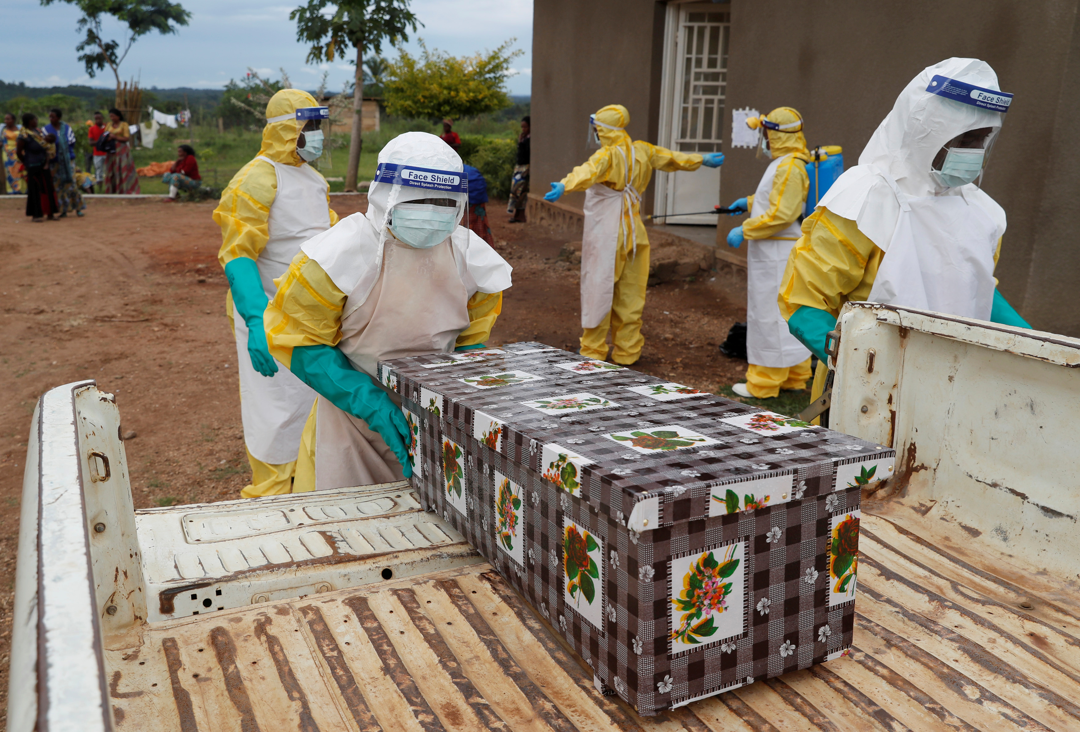 FILE - Healthcare workers carry the coffin of a baby believed to have died of Ebola, in Beni, North Kivu Province of Democratic Republic of Congo, Dec. 15, 2018.