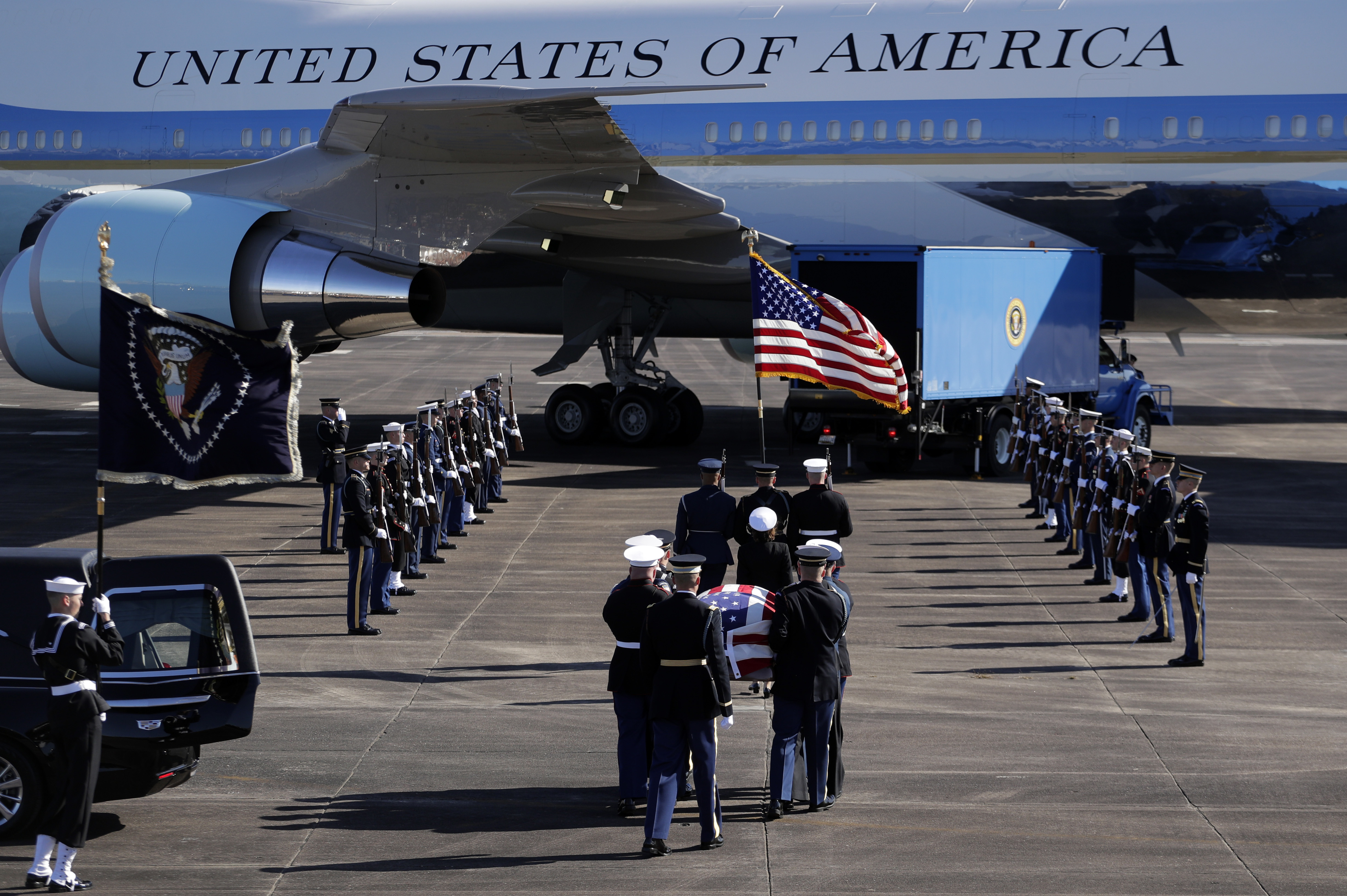 The flag-draped casket of former President George H.W. Bush is carried by a joint services military honor guard to Special Air Mission 41 at Ellington Field during a departure ceremony Monday, Dec. 3, 2018, in Houston, TX.