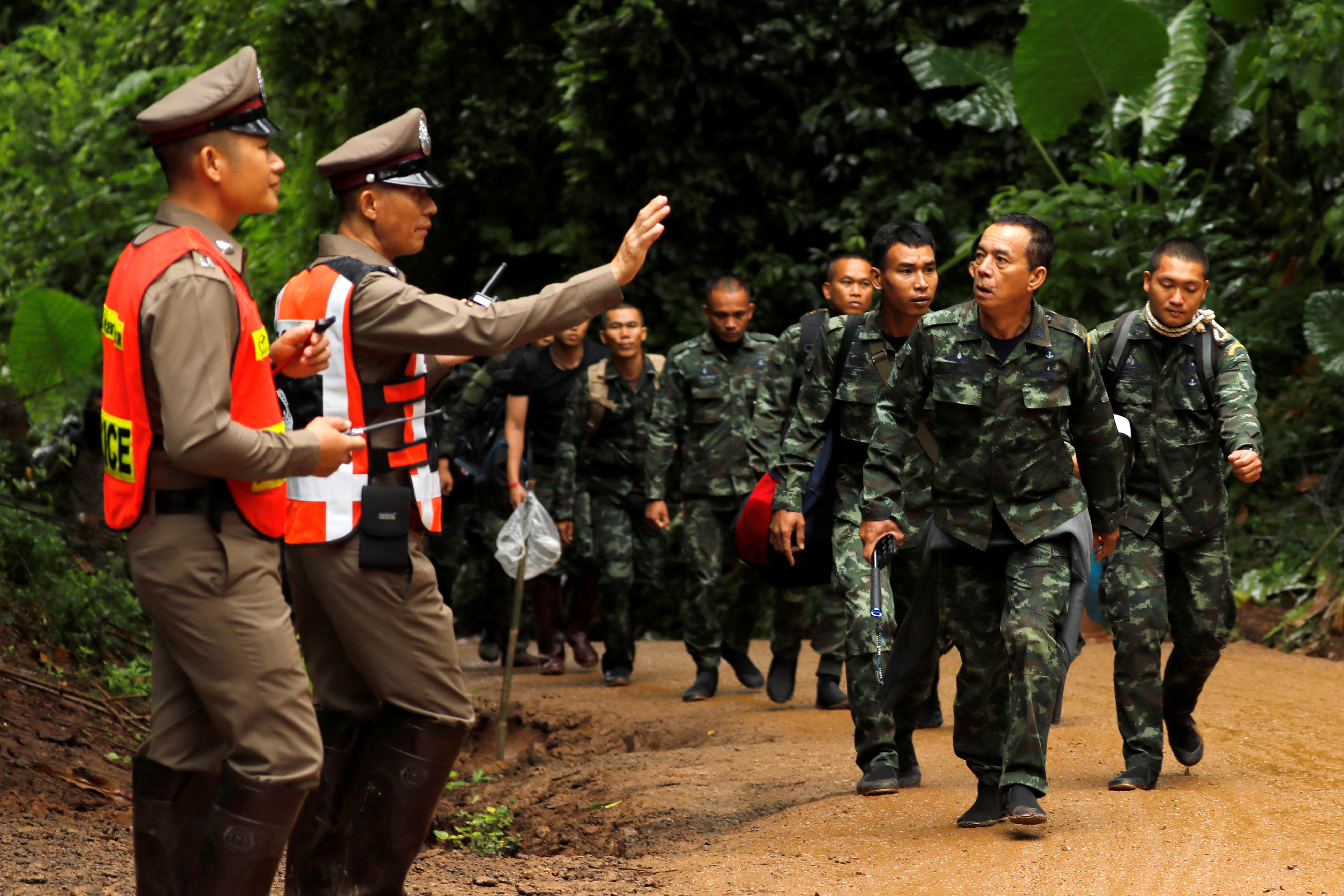 Soldiers arrive outside the Tham Luang cave complex, where 12 schoolboys and their soccer coach are trapped inside a flooded cave, in the northern province of Chiang Rai, Thailand, July 8, 2018.