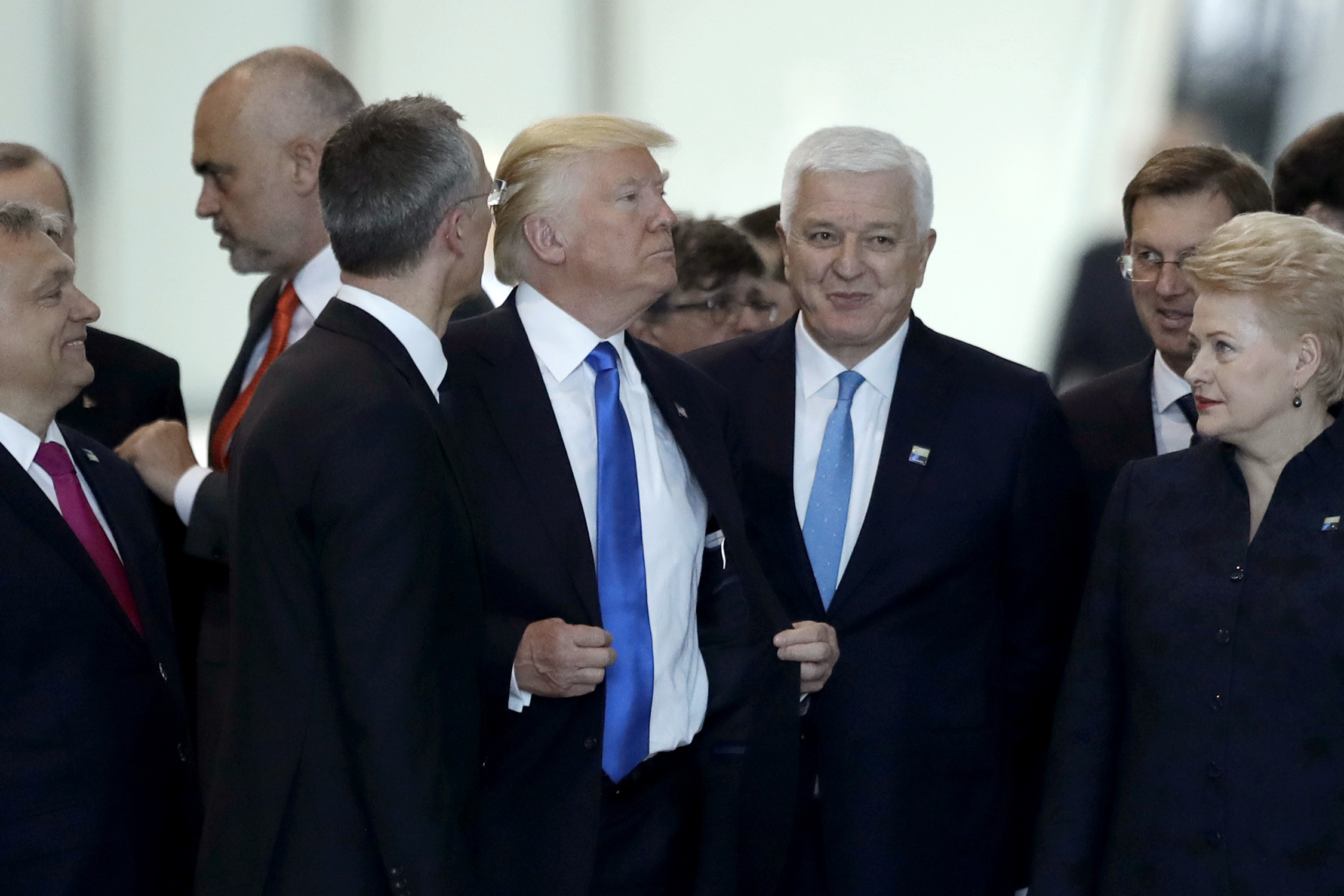 Montenegro Prime Minister Dusko Markovic, center right, after appearing to be pushed by Donald Trump, center, during a NATO summit of heads of state and government in Brussels, May 25, 2017.
