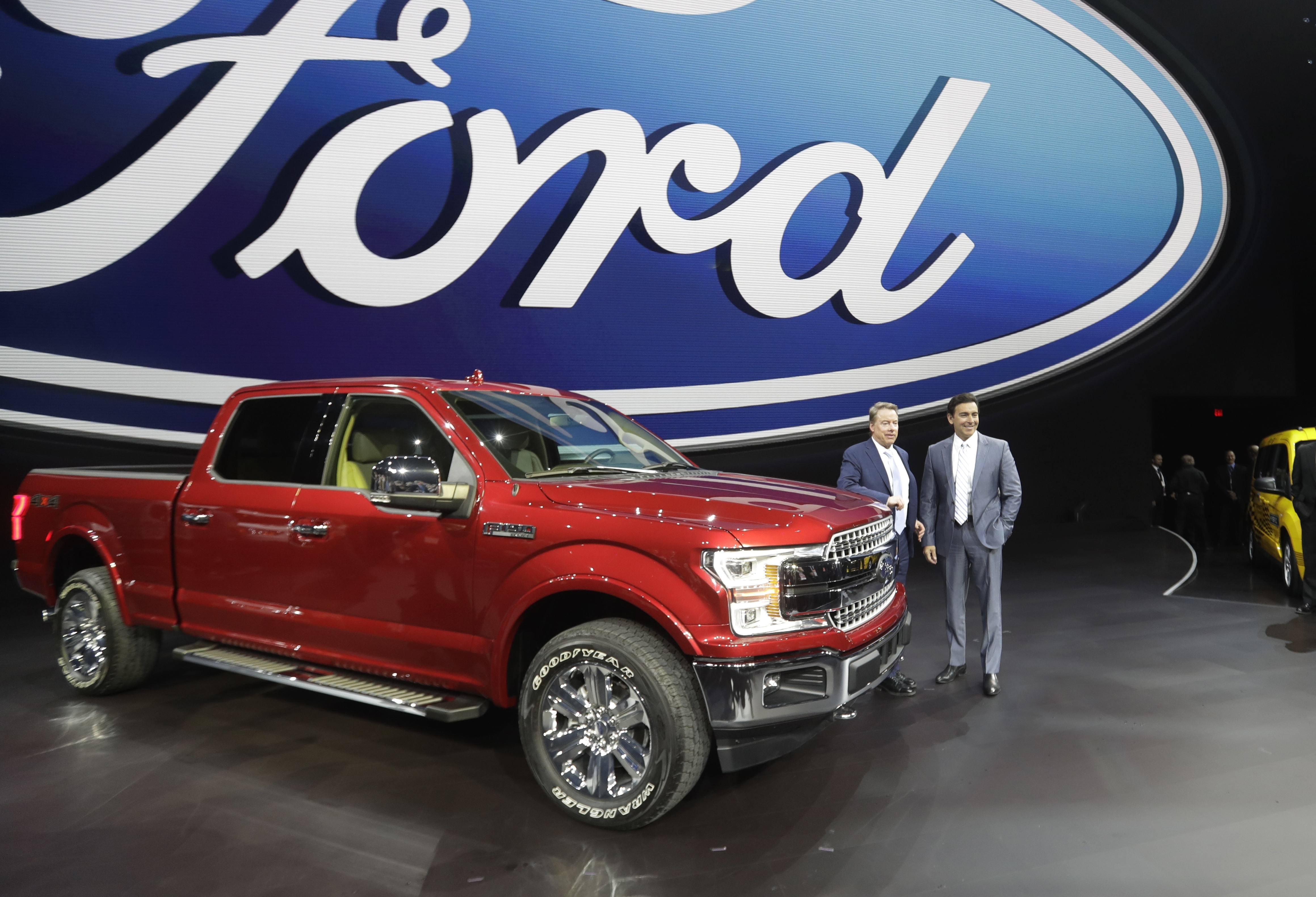 Ford Motor Co. Executive Chairman Bill Ford, left, and Chief Executive Mark Fields stand next to a Ford F-150 truck at the North American International Auto show, Jan. 9, 2017, in Detroit.