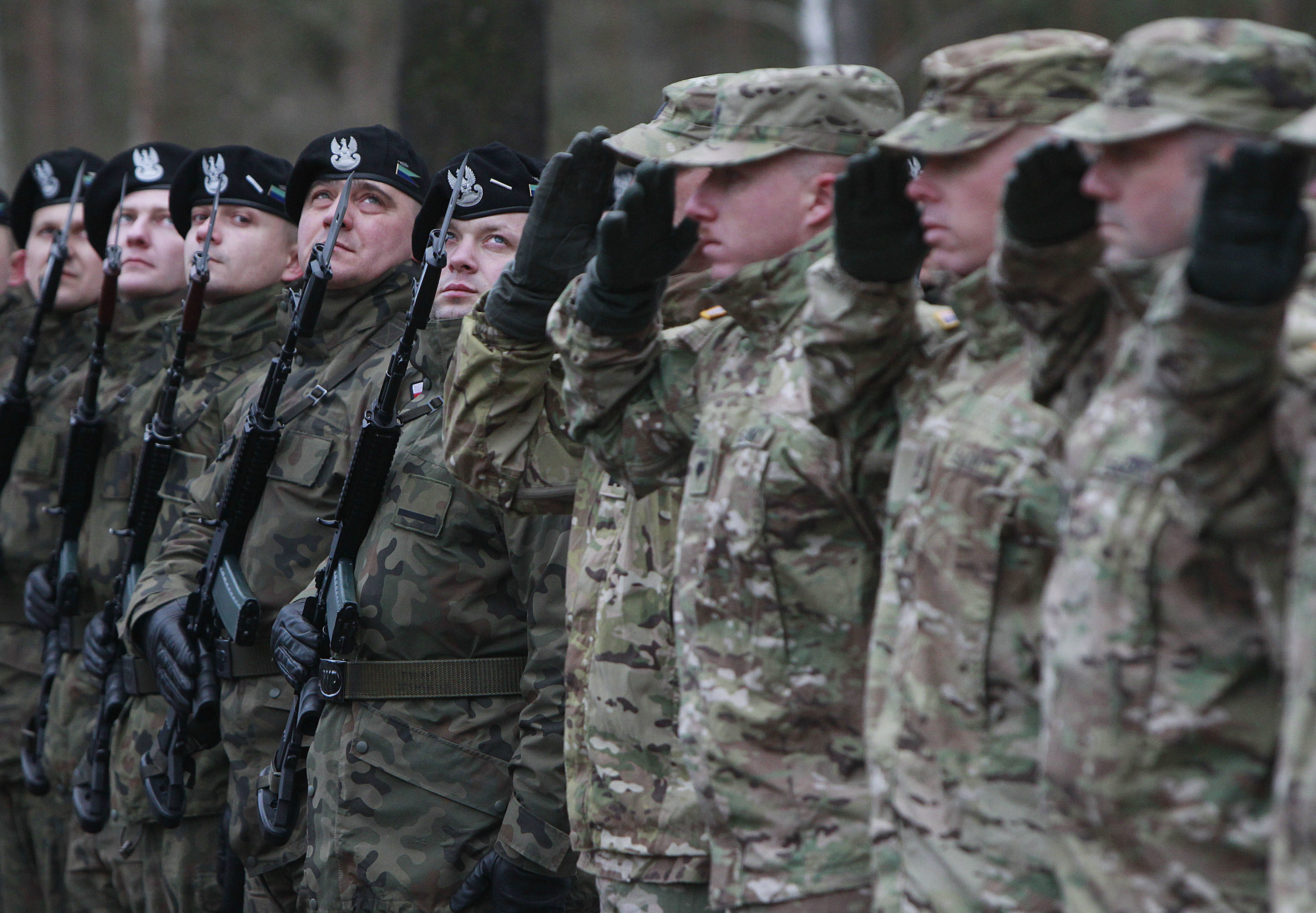 FILE - The  first U.S. troops arrive at the Zagan base in western Poland as part of deterrence force of some 1,000 troops to be based there, Jan. 12, 2017