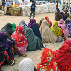 Internally displaced Somali women queue to receive food-aid rations at a distribution center in a displaced persons camp in the Somali capital Mogadishu, July 26, 2011