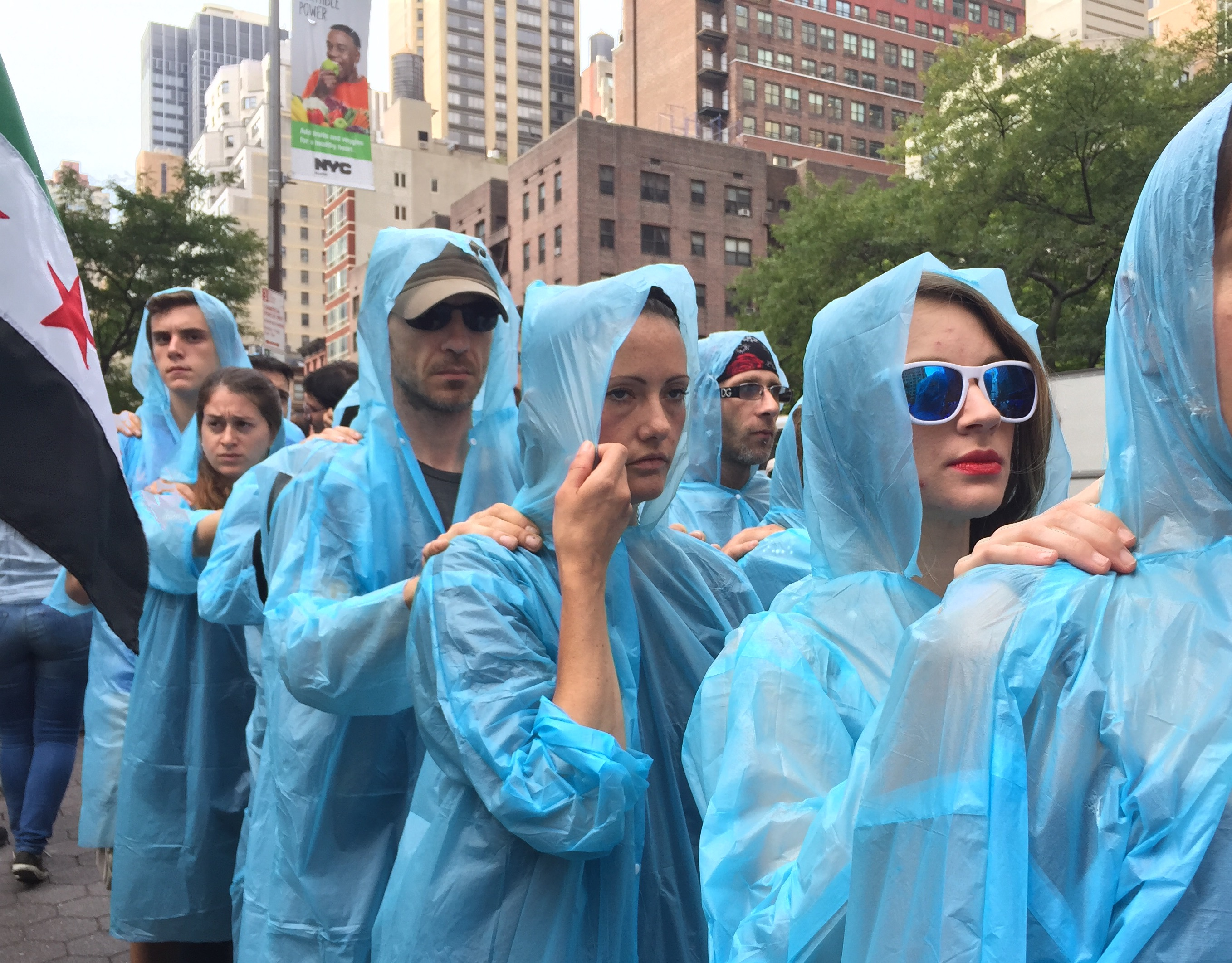 """An artistic protest performance called """"Backward march:  The World Backs Down to Iranian Terror.""""  These protesters marched 3 kilometers backwards to the United Nations as Iranian President Hassan Rouhani was speaking to the UN General Assembly.  The..."""