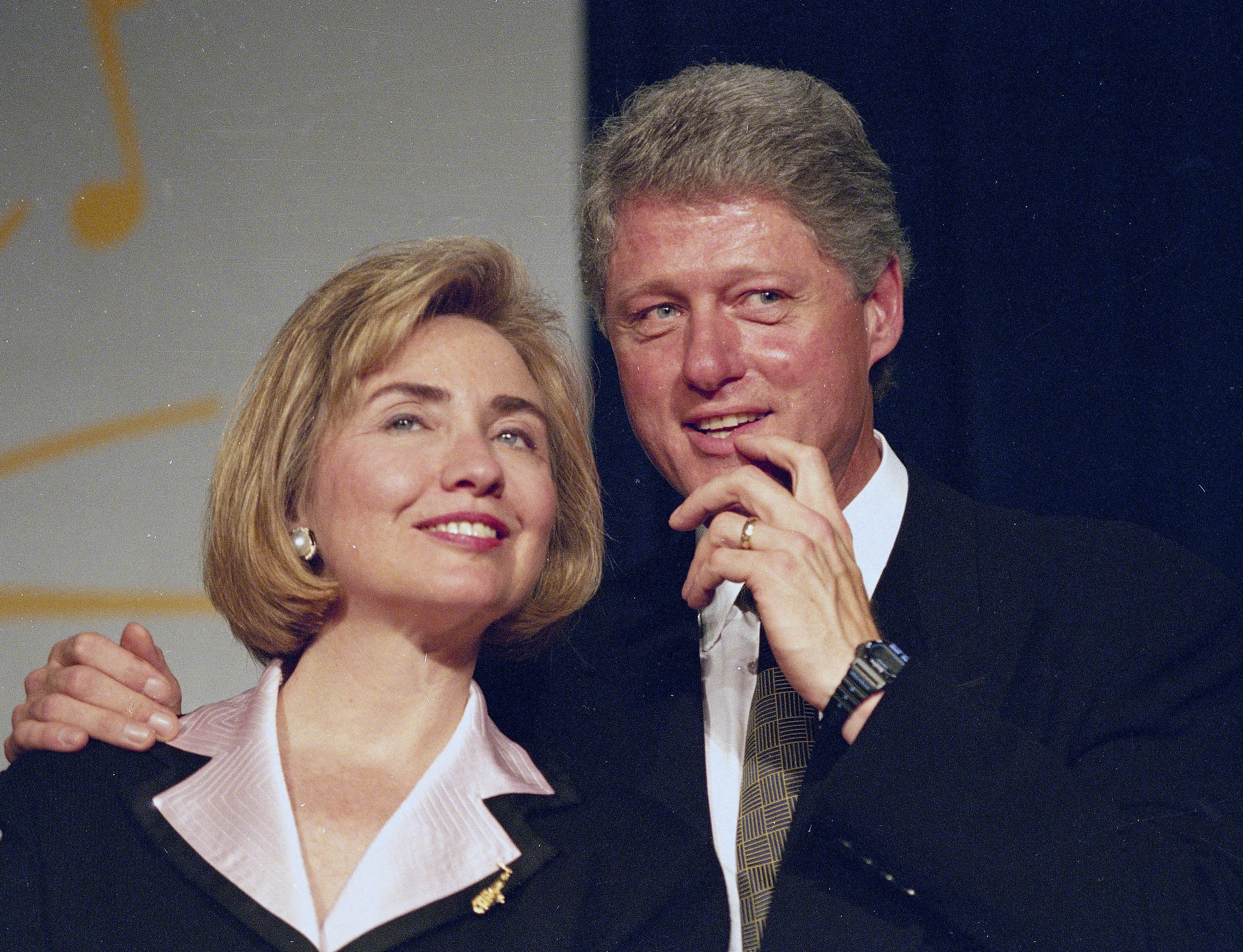 FILE - In this June 22, 1994 file photo, President Bill Clinton and first lady Hillary Clinton wait to address a group of young Democratic supporters known as the Saxophone Club in Washington.
