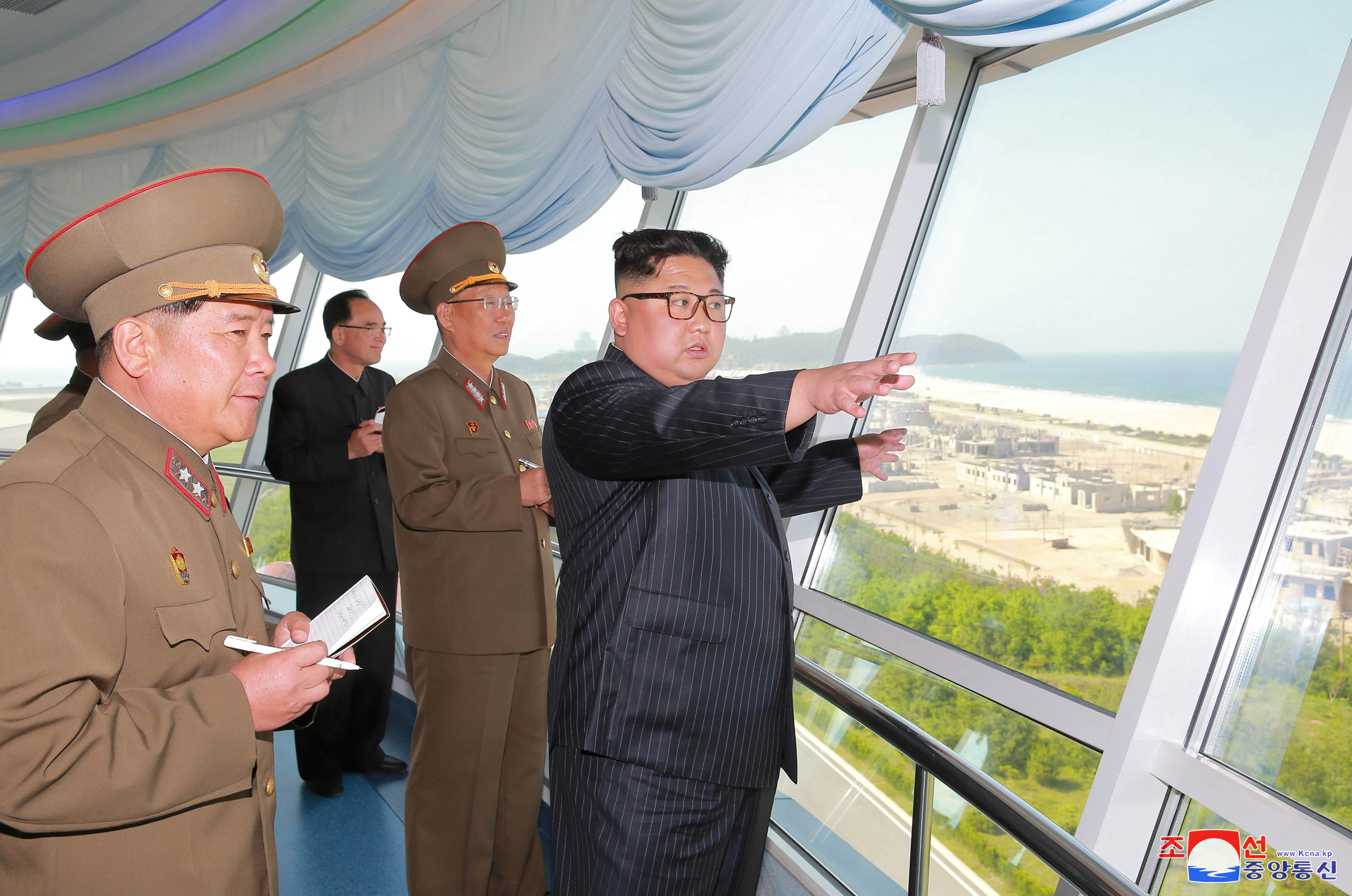 FILE PHOTO - North Korean leader Kim Jong Un inspects the construction site of the Wonsan-Kalma coastal tourist area as Kim Su Gil, 3rd from left, newly appointed director of the General Political Bureau of the Korean People's Army, looks on, in this...