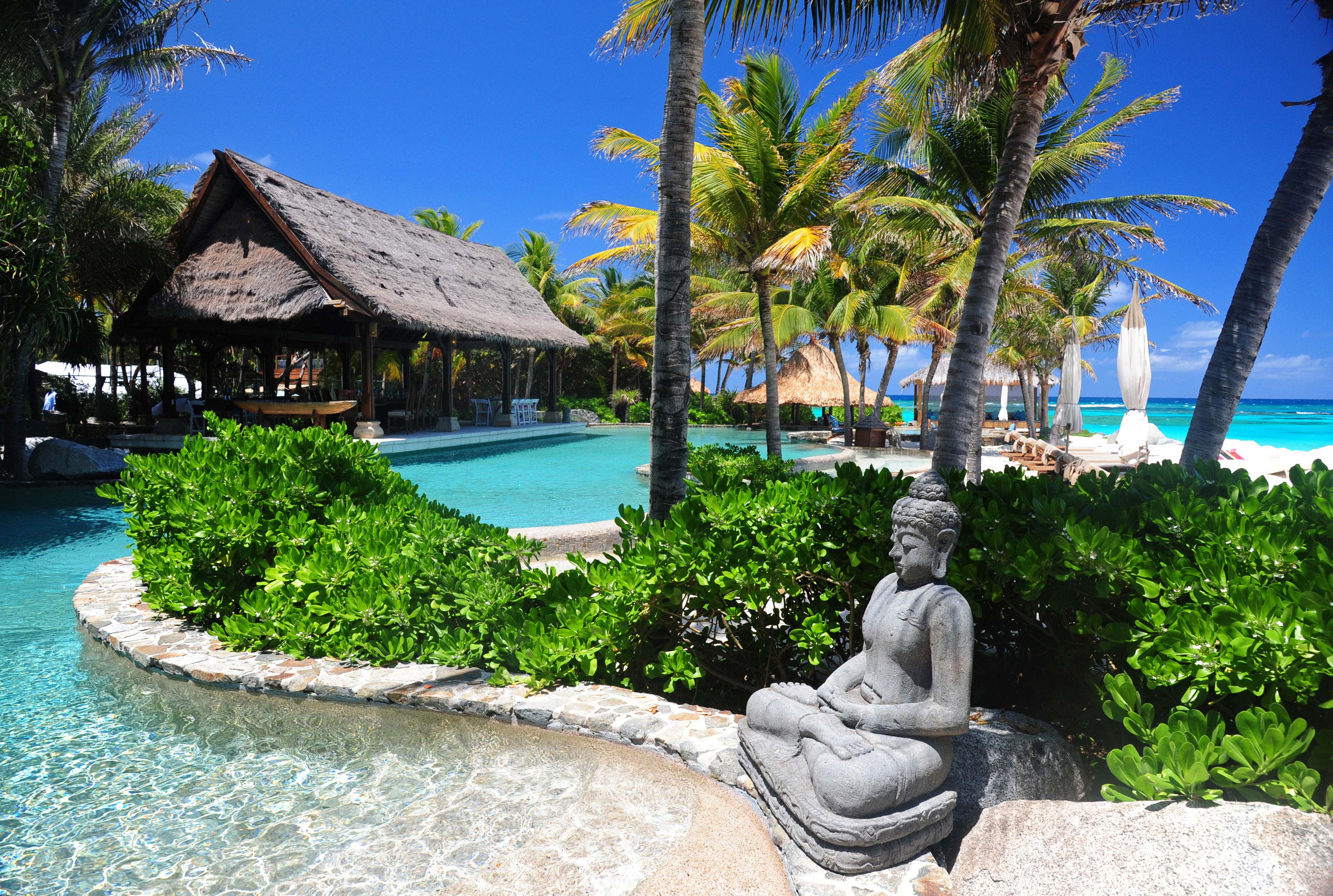 FILE - A statue decorates the pool area of Richard Branson's property on Necker Island in the British Virgin Islands.