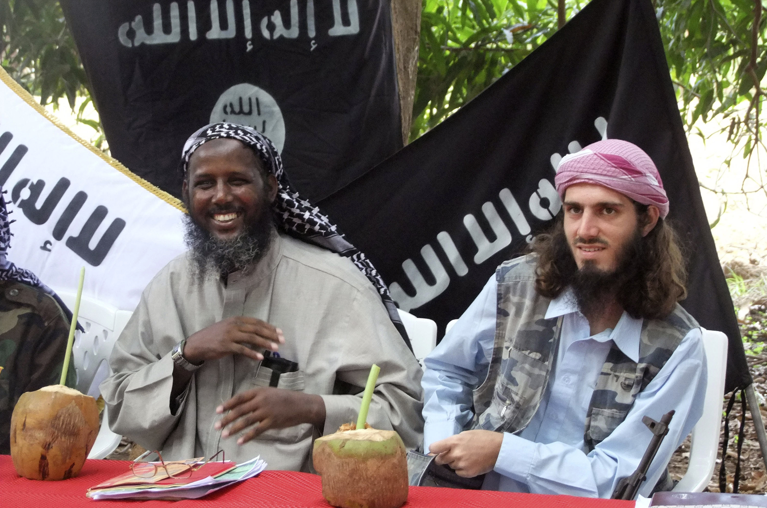 FILE - Mukhtar Robow, then a leader of the Somali militant group al-Shabab, is seen at a news conference at a farm in southern Mogadishu's Afgoye district in Somalia, May 11, 2011.