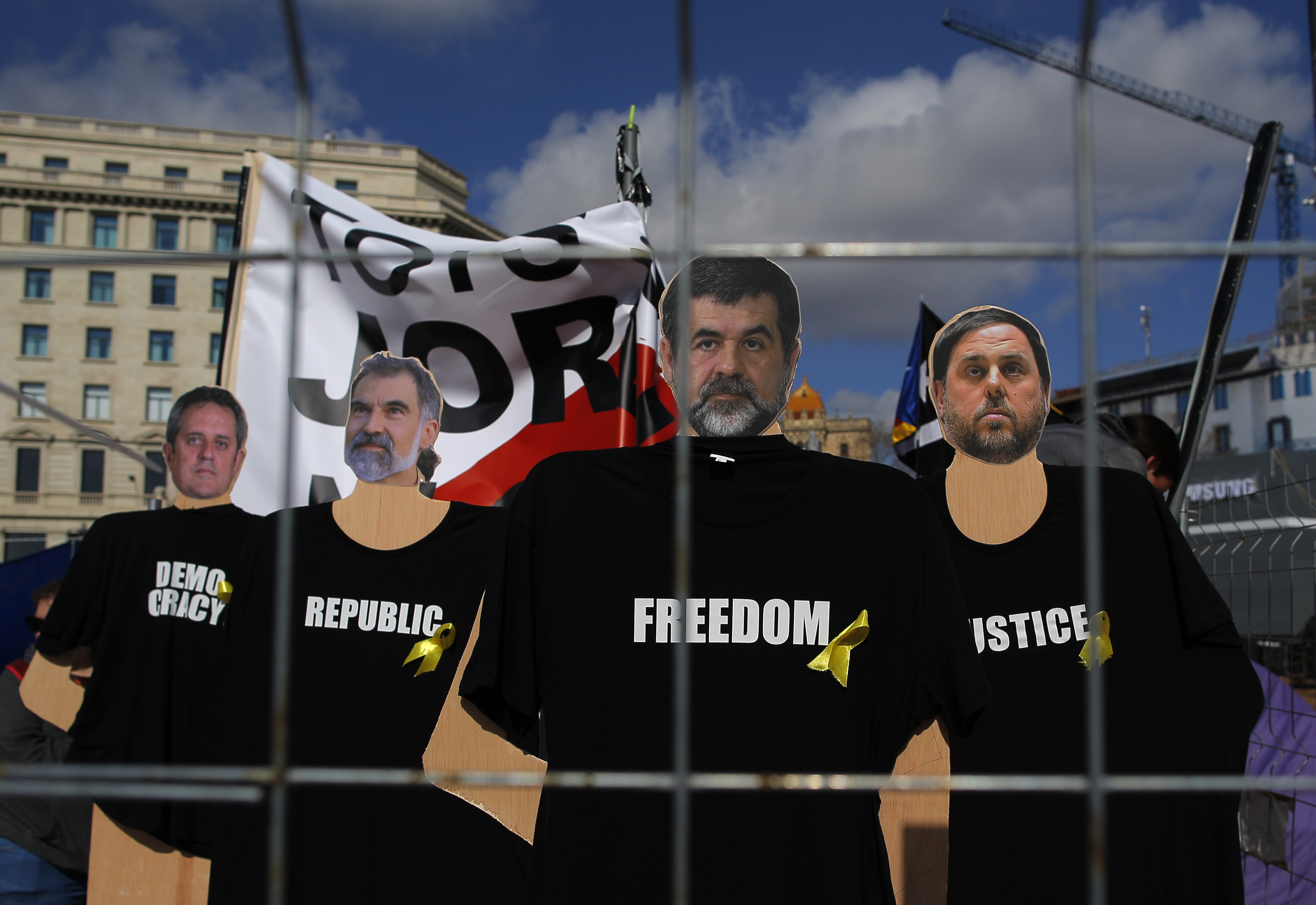 Pictures of the politicians imprisoned are displayed during a protest at the Catalunya square in Barcelona, Spain, Feb. 18, 2018.