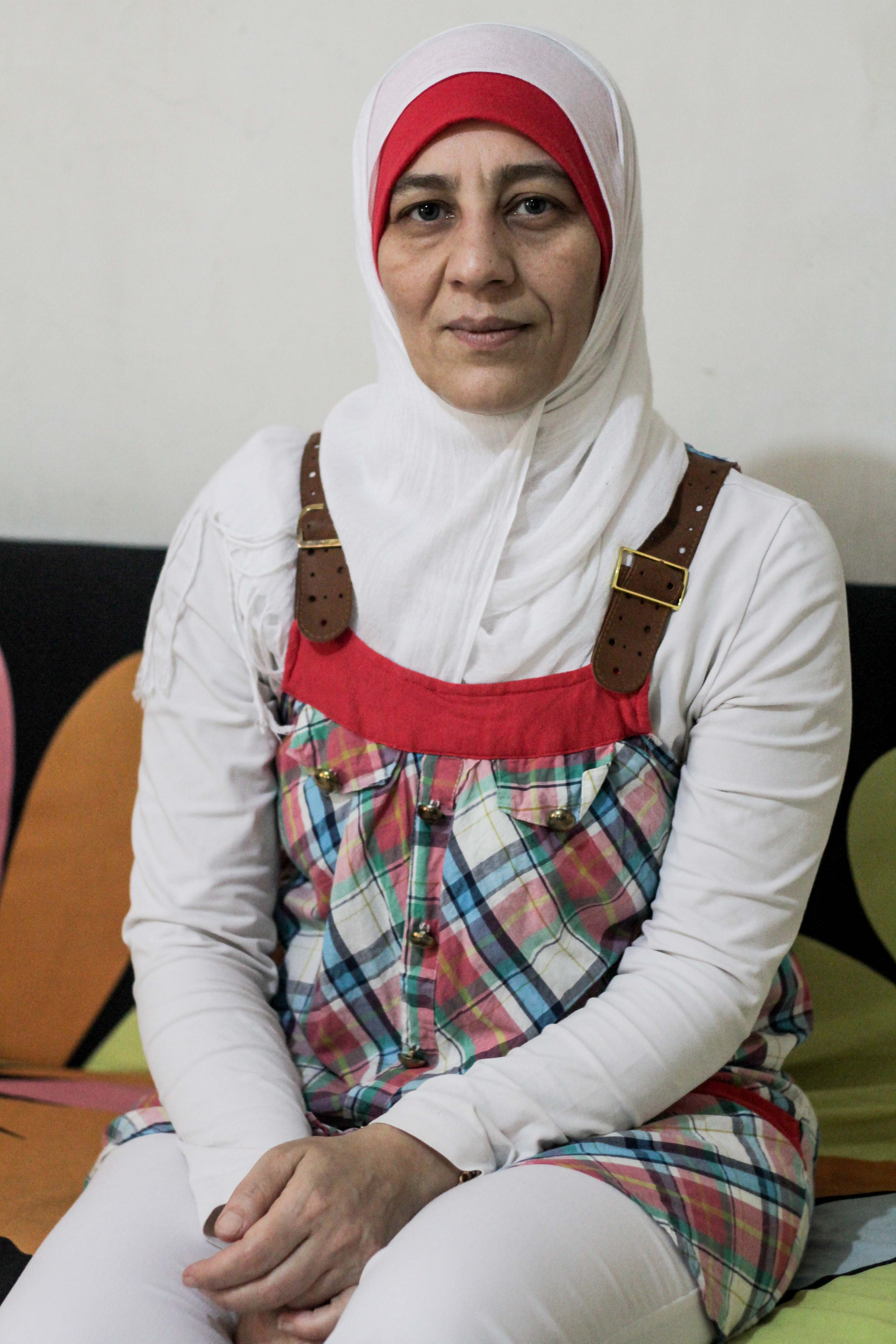 After four years of having her son rejected from Lebanese schools, Nidal's mother Hasiba hopes he and his two siblings can now enter full-time education, Beirut, Lebanon, Sept. 17, 2015. (VOA / J. Owens)