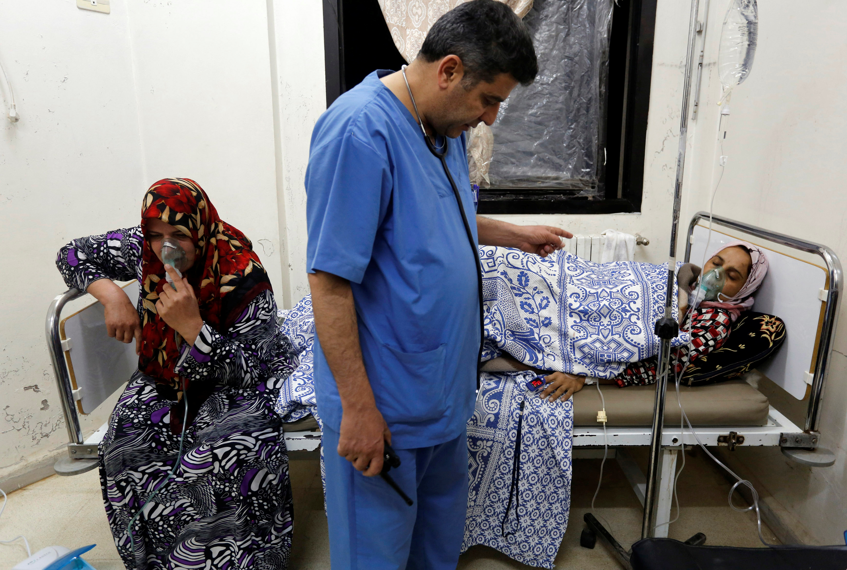 Women, affected by what activists say was a gas attack, receive treatment inside a makeshift hospital in Kfar Zeita village in the central province of Hama, Syria May 22, 2014.