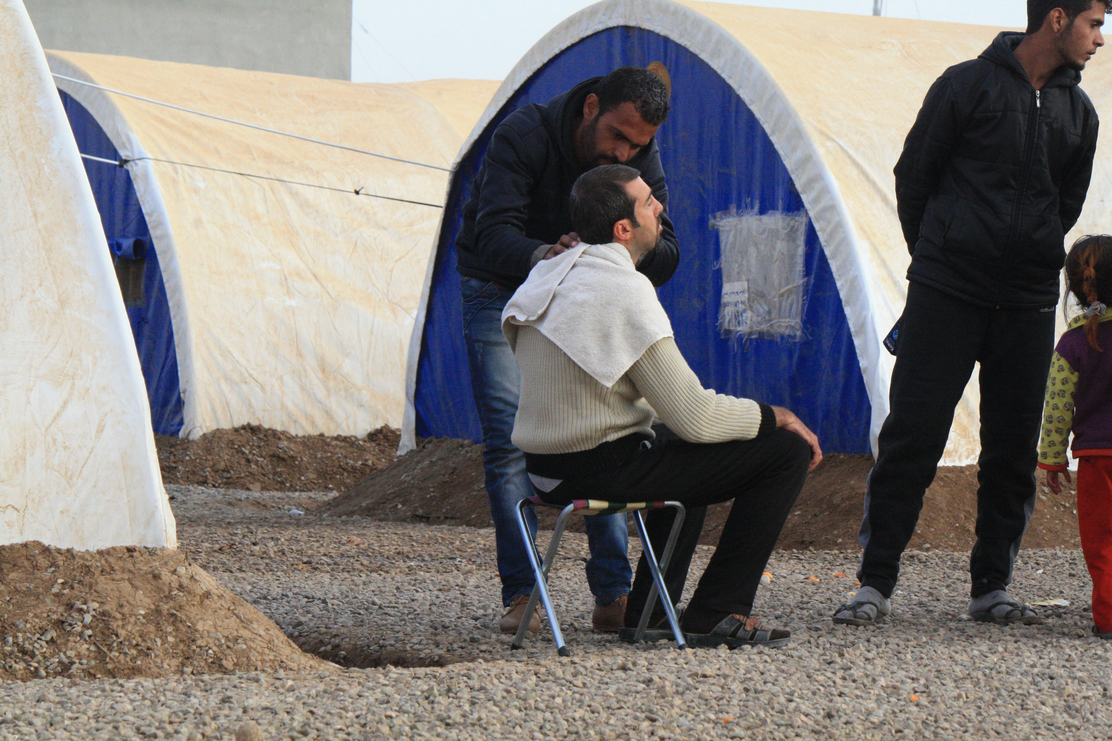 Many former Mosul barbers say they continued to practice despite the danger because they had no other way to buy food for their families, at the Khazir camp in Kurdish Iraq, Dec. 13, 2016. (H. Shekha/VOA)