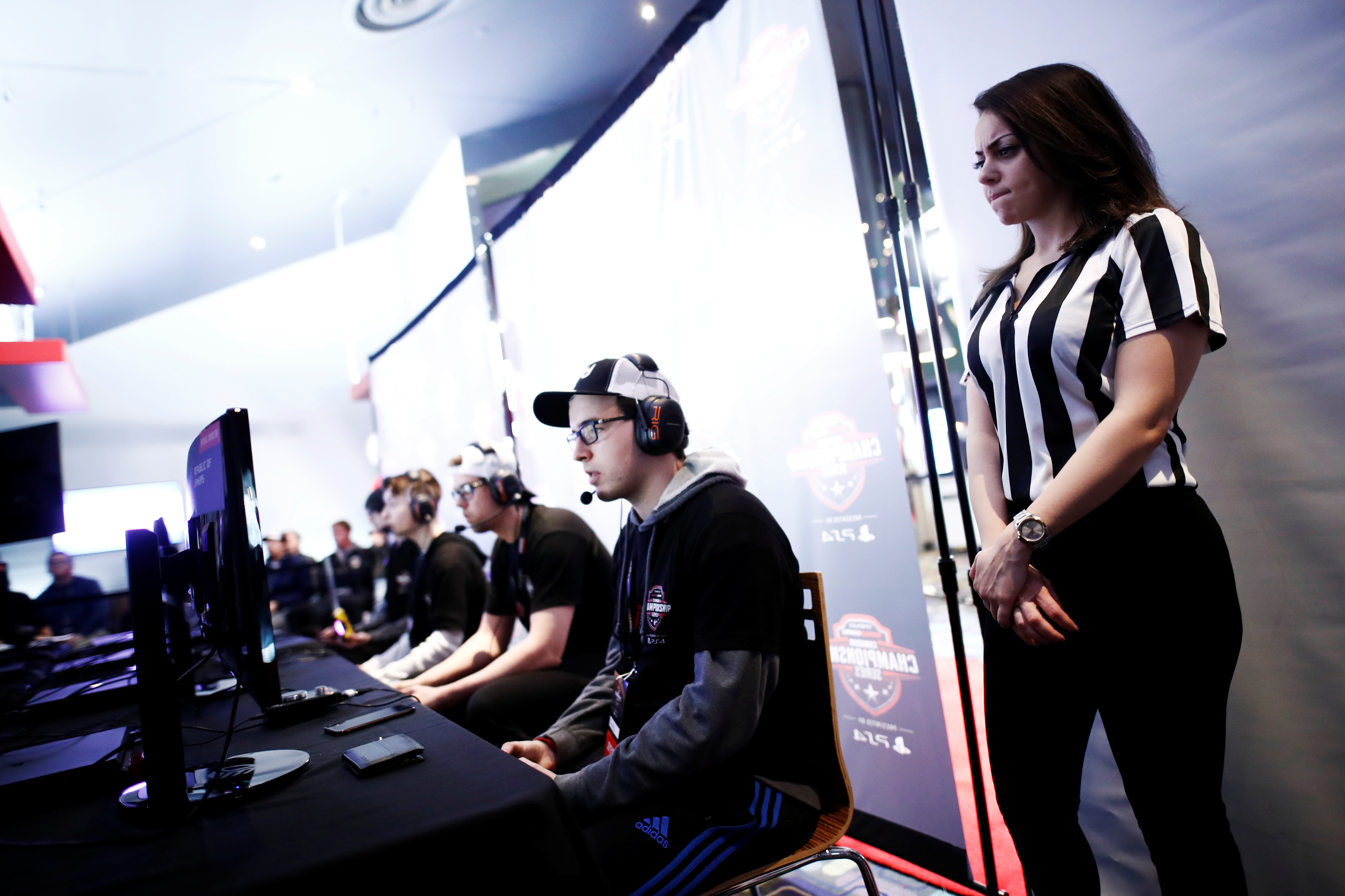 """A referee watches over competitors playing """"Call of Duty: Infinite Warfare"""" on the Playstation 4, during the Cineplex WorldGaming Canadian Championship Series, an esports video game tournament, n Toronto, Ontario, March 26, 2017."""