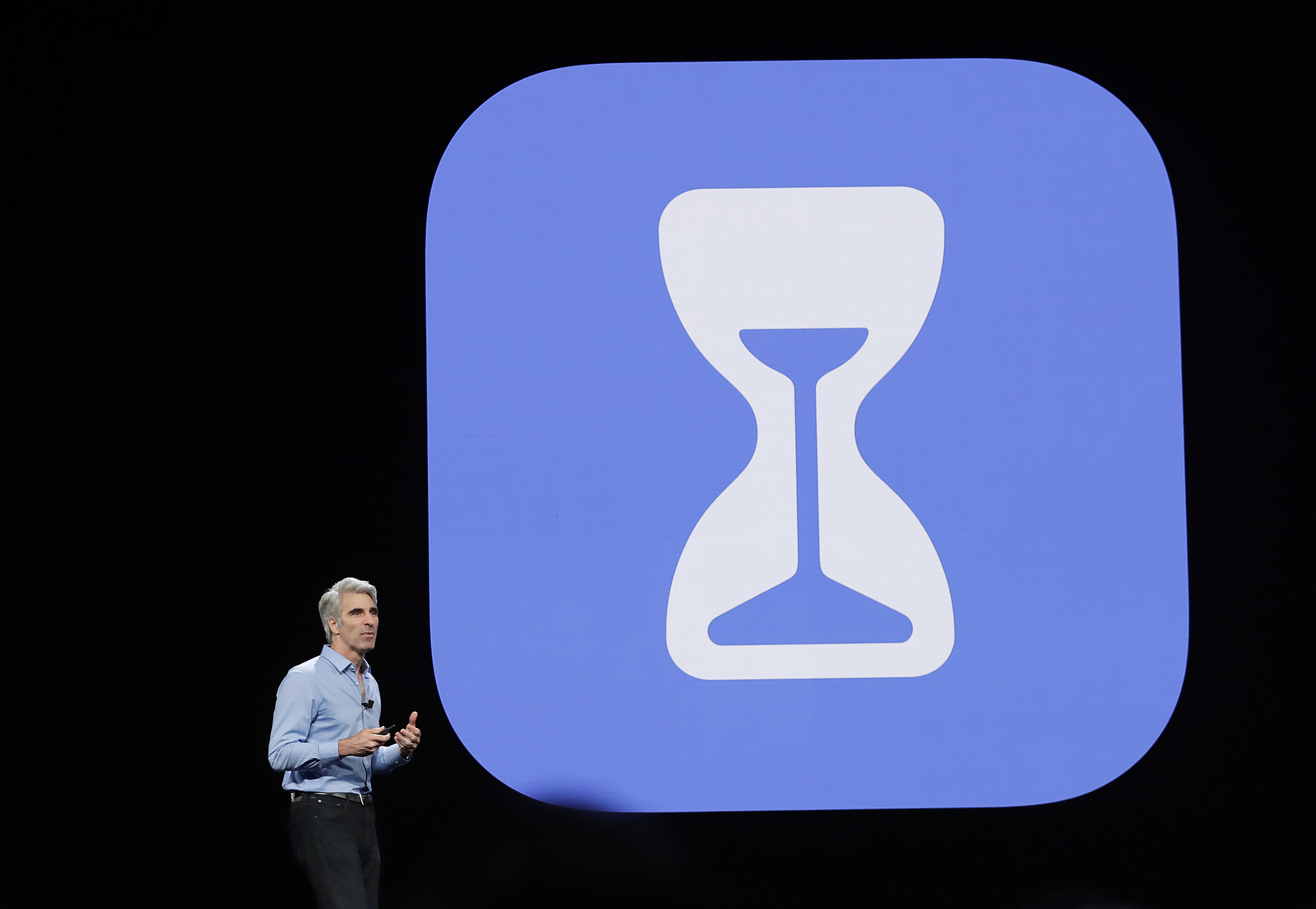 "Craig Federighi, Apple's senior vice president of software engineering, speaks about the company's ""Screen Time"" feature during an announcement of new products at the Apple Worldwide Developers Conference, June 4, 2018, in San Jose, Calif."