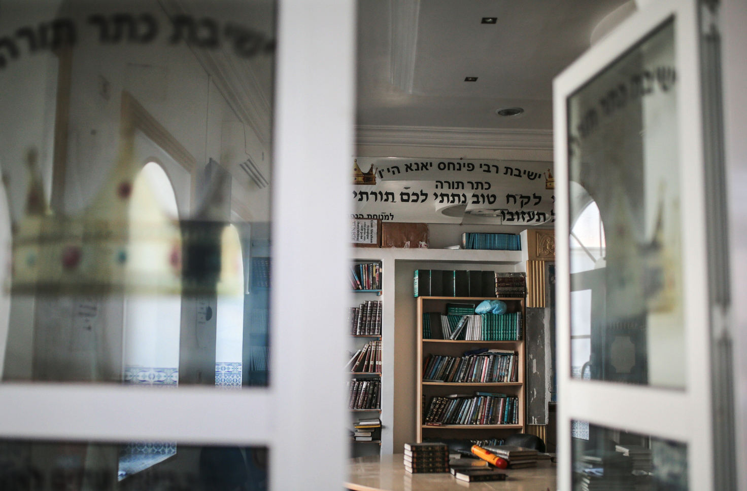 Jewish holy books are seen at a library at Hara Kbira, the main Jewish neighborhood on the Island of Djerba, southern Tunisia, Oct. 30, 2015.