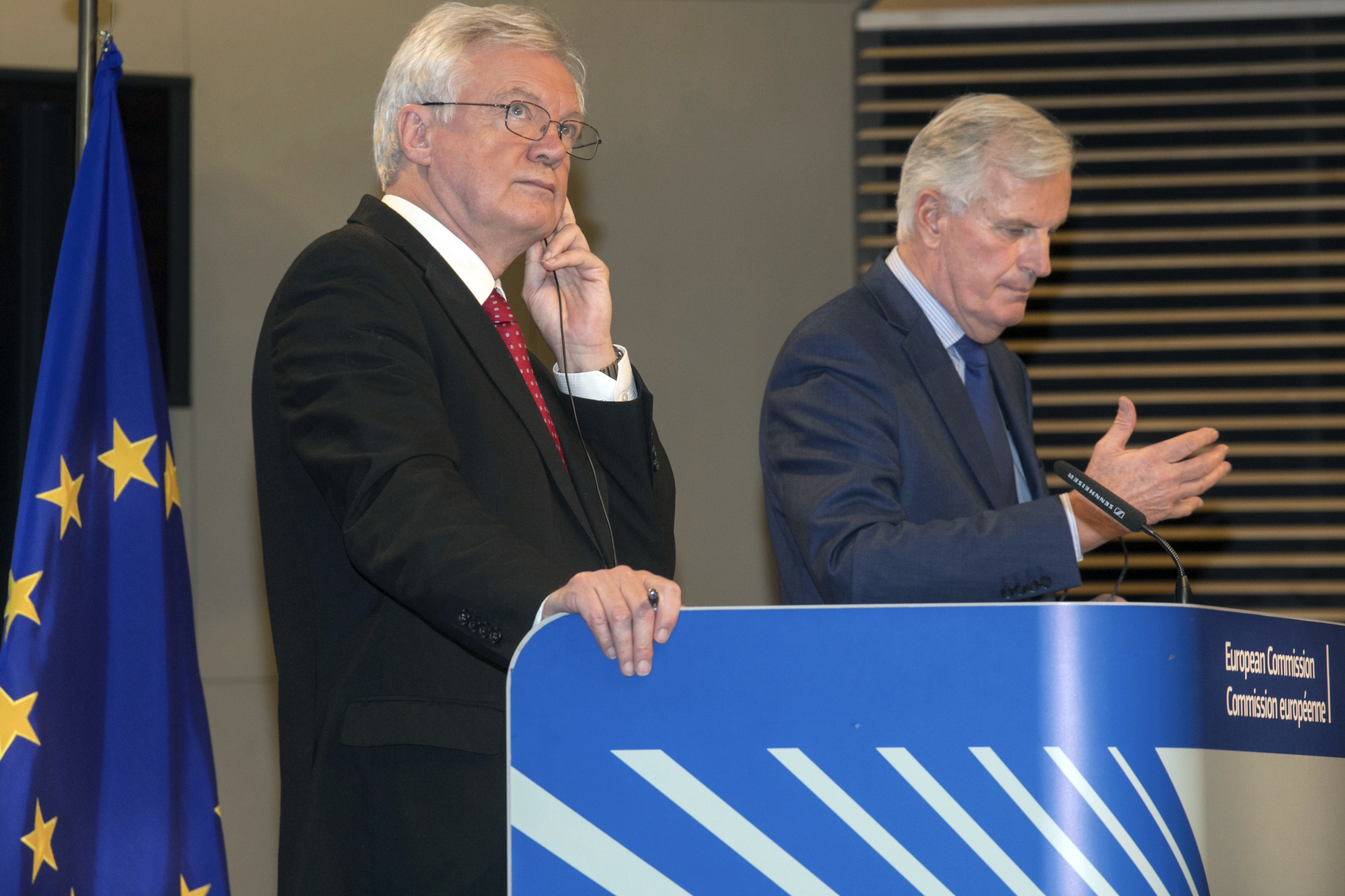 British Secretary of State for Exiting the European Union, David Davis left, and European Union chief Brexit negotiator Michel Barnier participate in a media conference at EU headquarters in Brussels, Oct. 12, 2017.