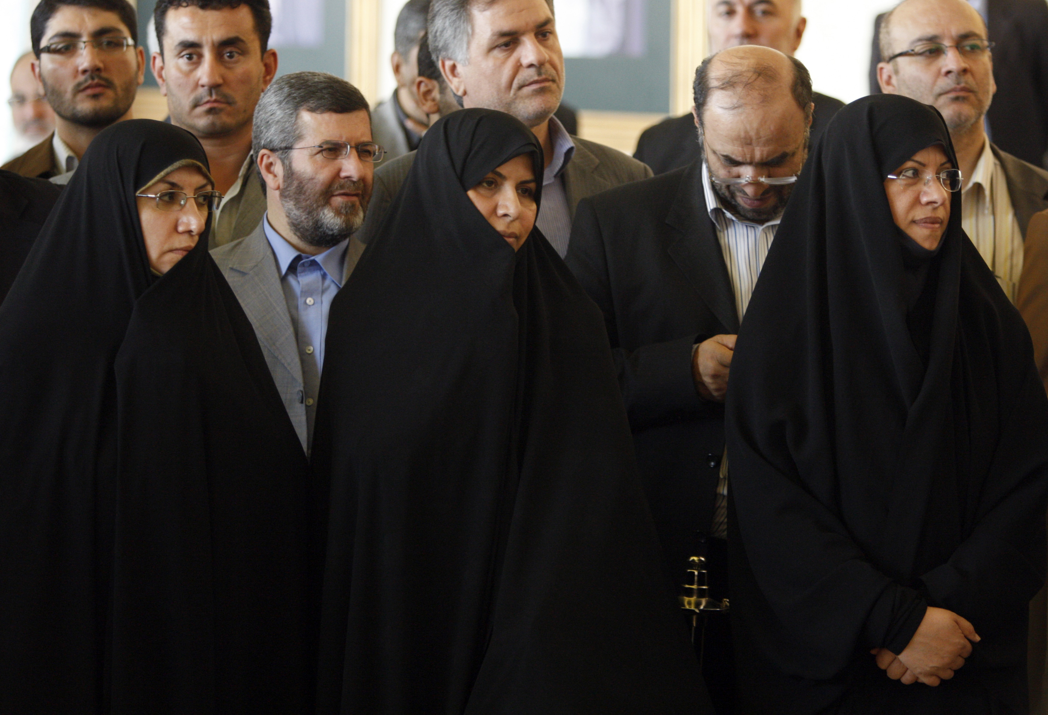 FILE - Then-Iranian Health Minister Marzieh Vahid Dastjerdi, center, stands with lawmakers during a press briefing in Tehran, Iran, Sept. 3, 2009.