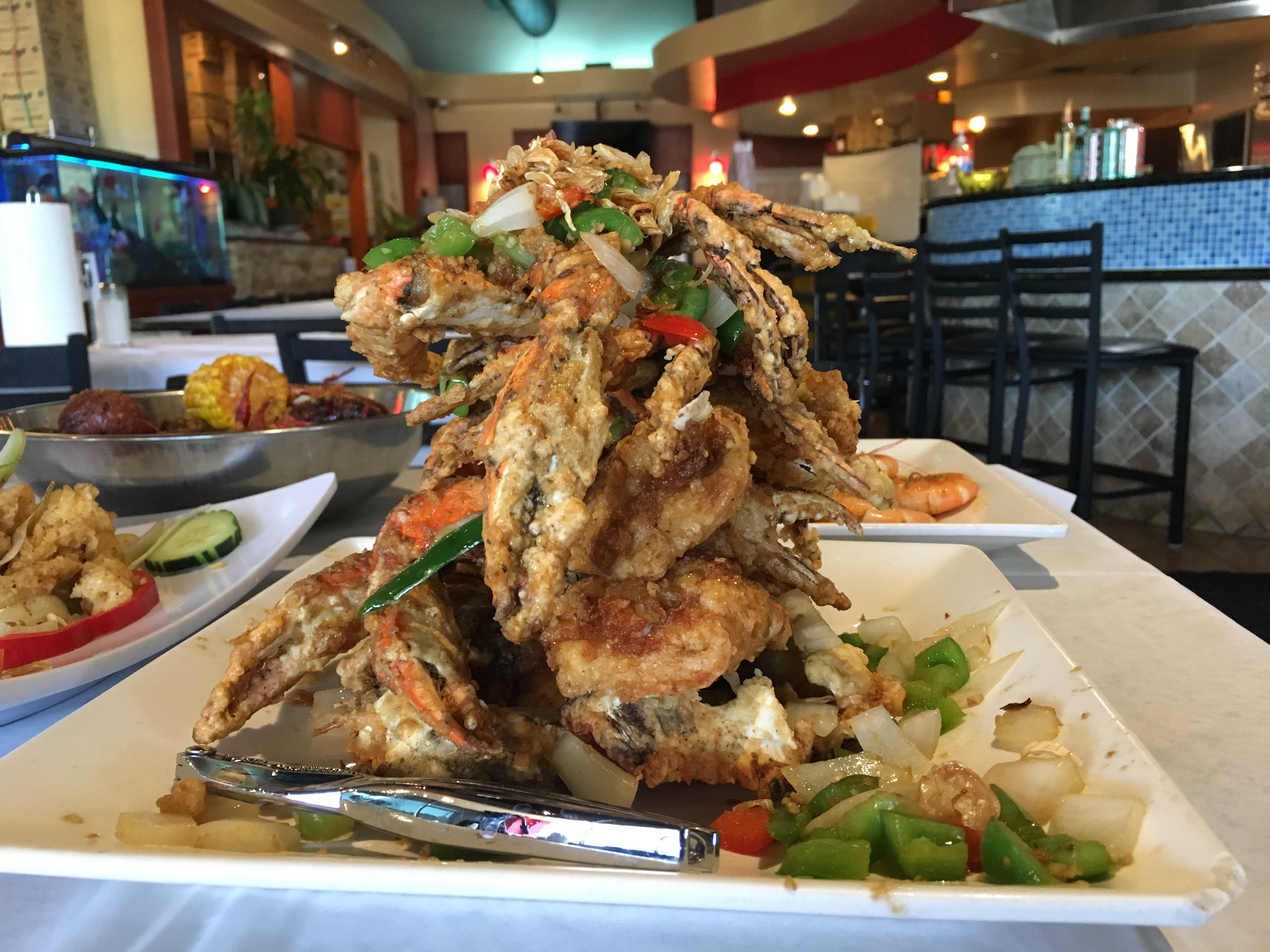 The salt and pepper crab is one of the popular dishes on the menu at the Houston-based restaurant, Crawfish & Noodles, which specializes in Vietnamese-Cajun styled seafood.
