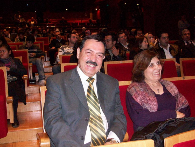 Taofik Alhallak, left, and Zahrieh Alsouso await a theater performance in Damascus in this undated photo provided by their son.