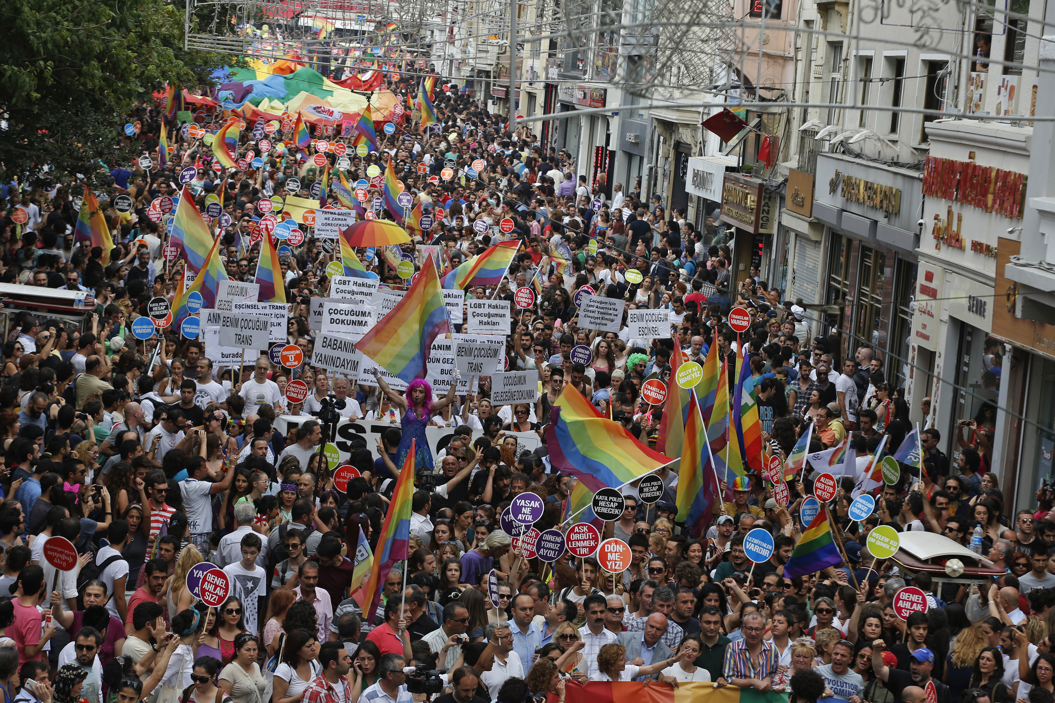 People march during a gay pride parade in Istanbul, June 30, 2013. Tens of thousands of anti-government protesters teamed up with a planned gay pride march in Istanbul. Crowds were stopped by riot police from entering Taksim, the center of previous p...