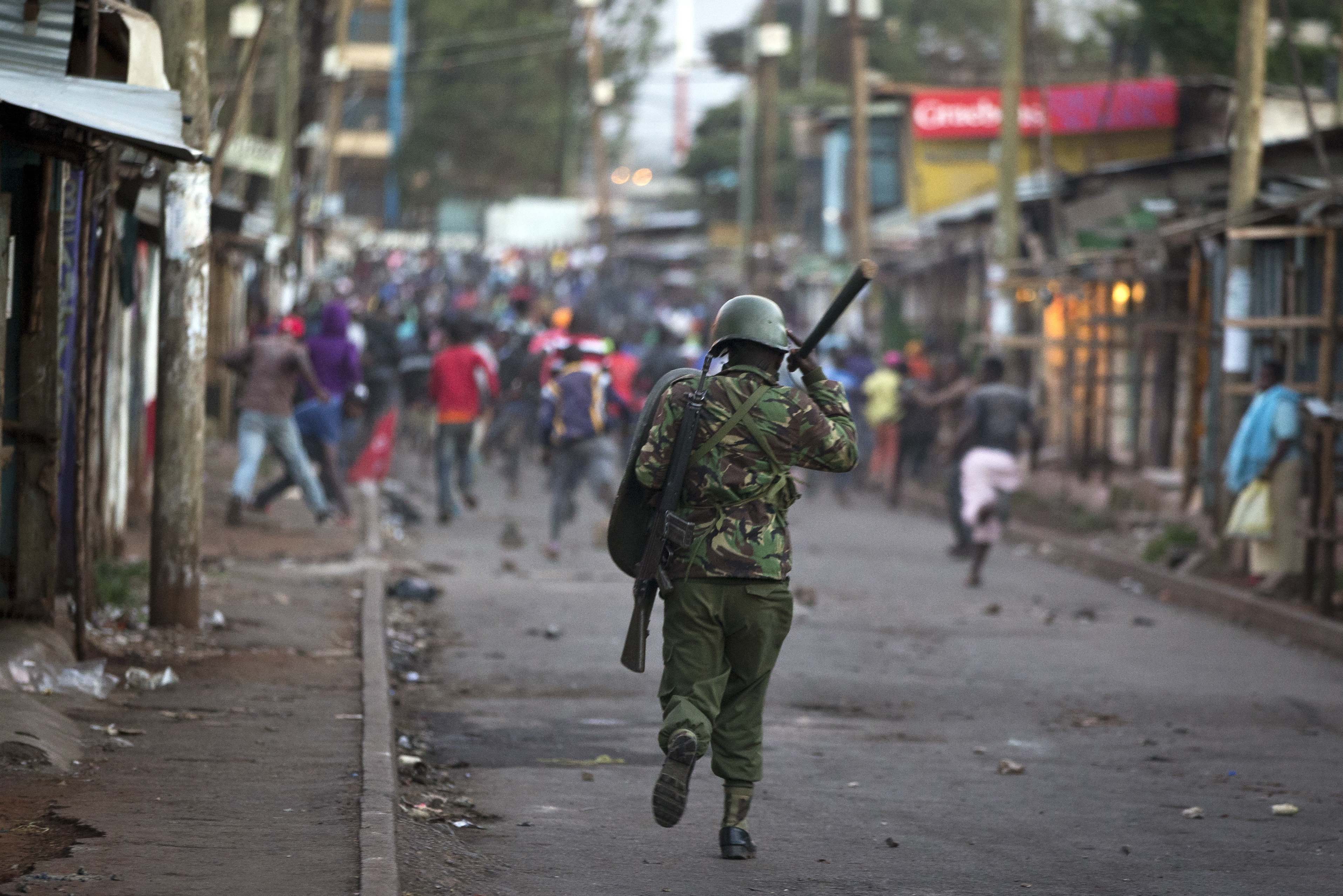 Opposition supporters run away from police during clashes after the election commission announced results from the Oct. 26 vote in the Kibera area of Nairobi, Kenya, Oct. 30, 2017.
