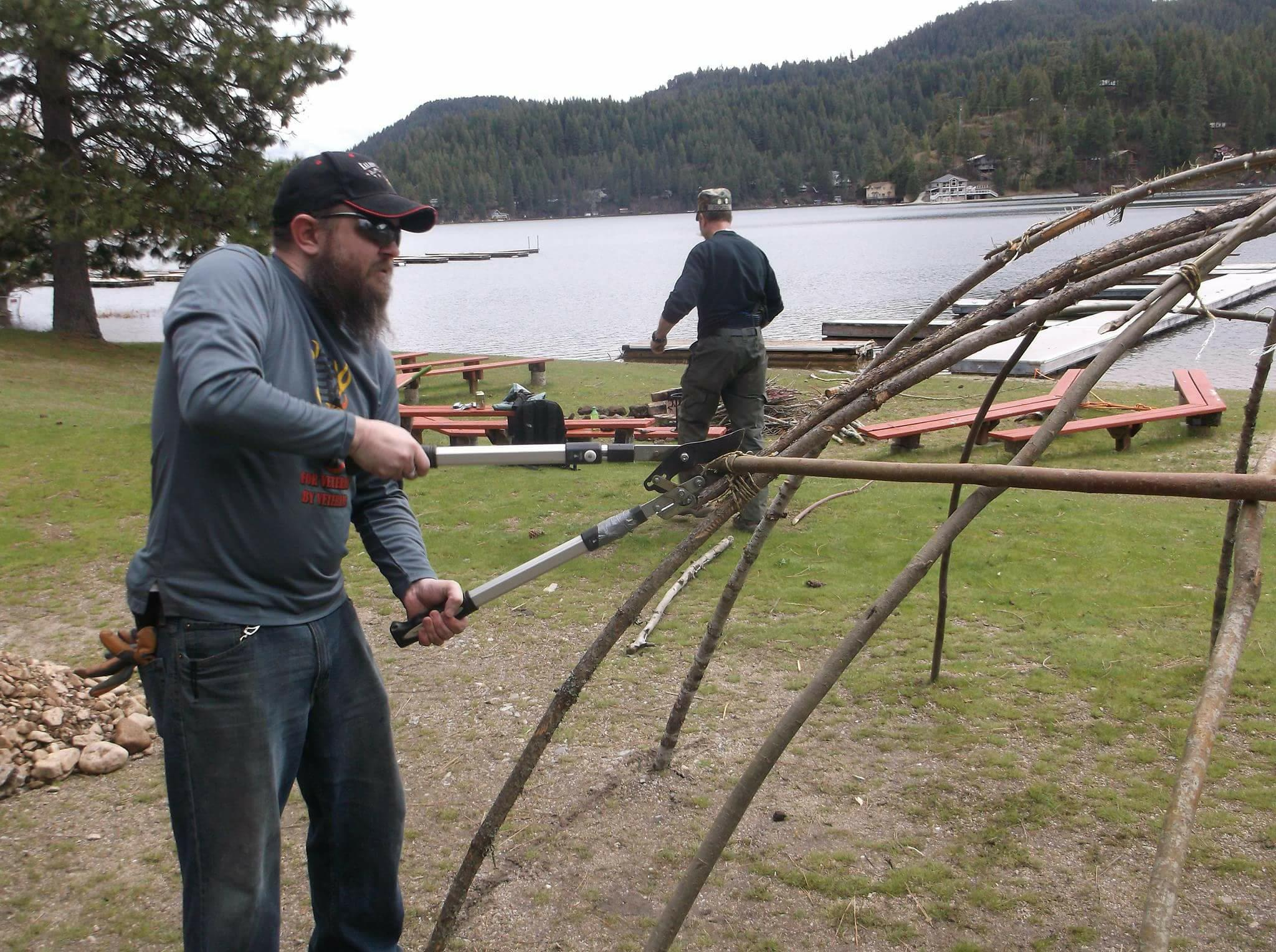 Iraq War veteran Michael Carroll, assisting in building the frame for a sweat lodge under the direction of Blackfeet Indian cultural advisors. Courtesy: Michael Carroll.