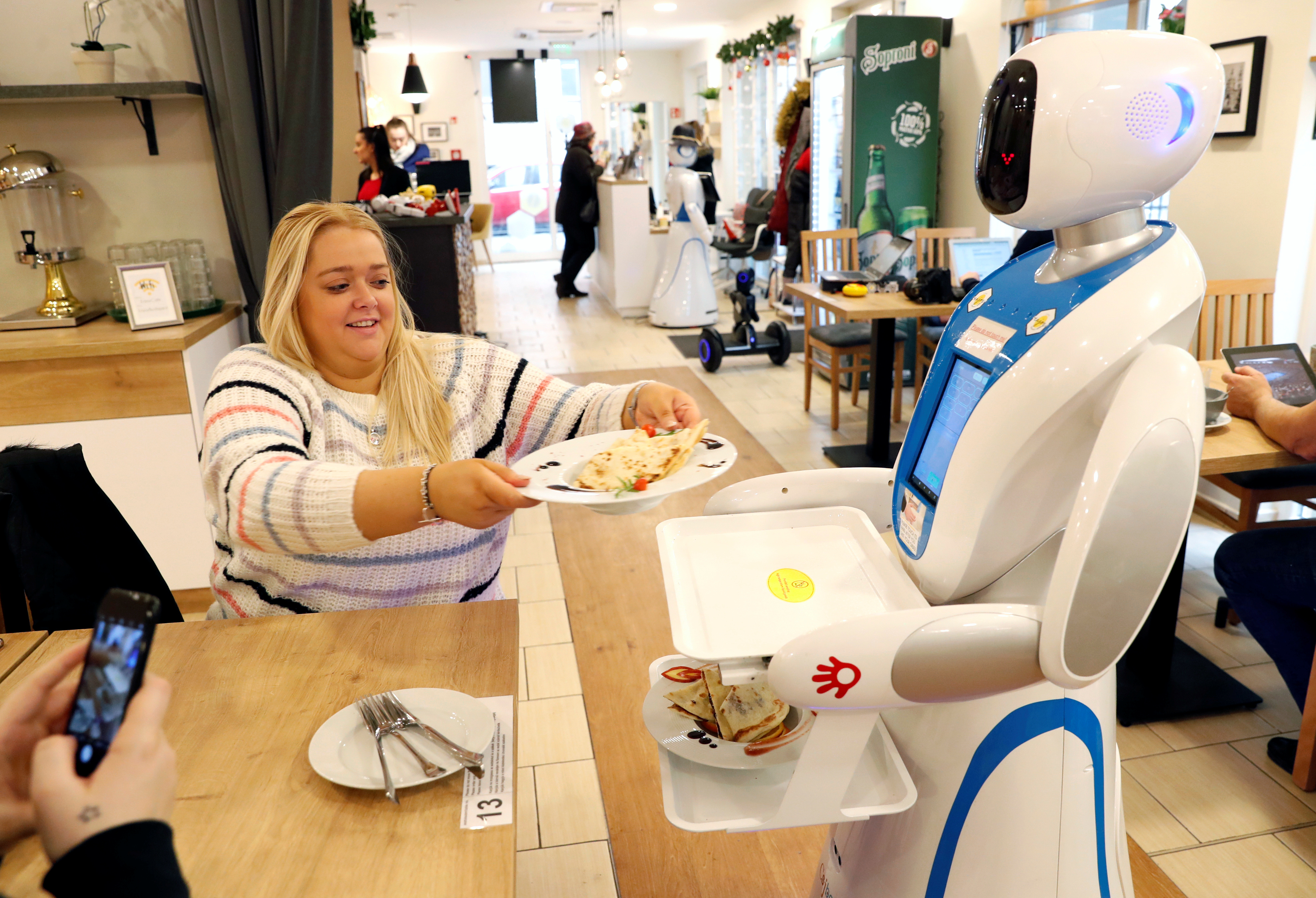A robot waiter serves customers at a cafe in Budapest, Hungary, Jan. 24, 2019.