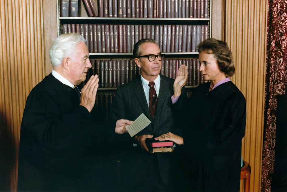 FILE - Sandra Day O'Connor, right, is sworn in as a Supreme Court Justice by Chief Justice Warren Burger as her husband, John O'Connor, looks on, in Washington, Sept. 25, 1981.