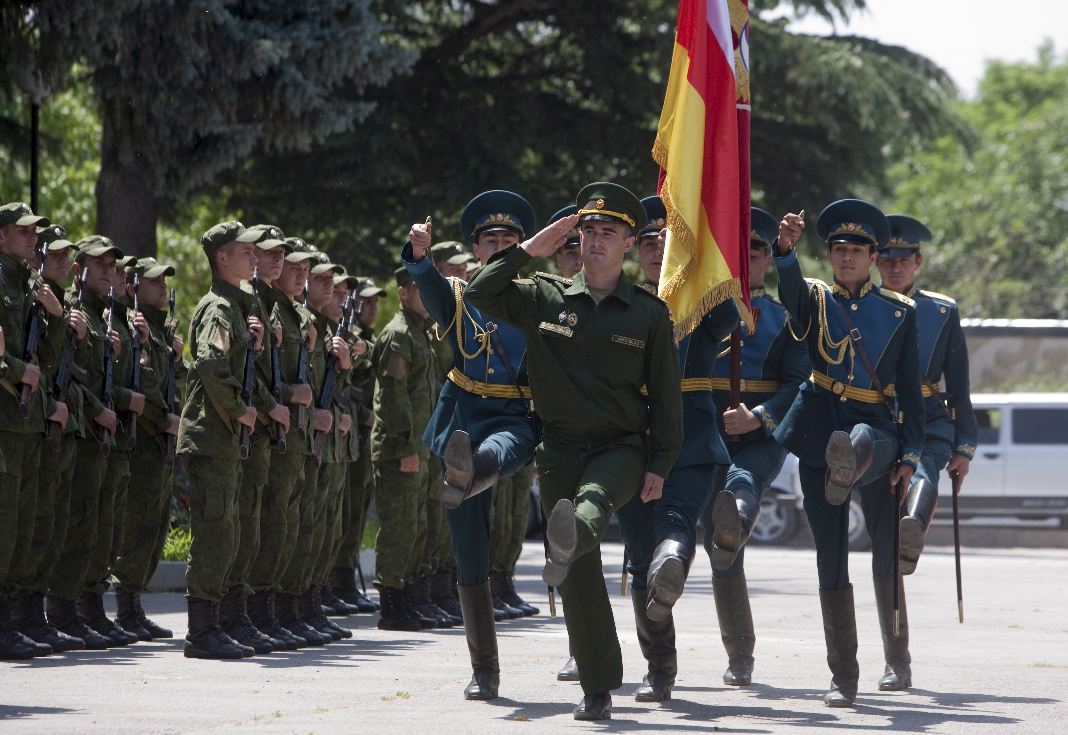 FILE - Servicemen of the military forces of South Ossetia march during an oath of allegiance ceremony in Tskhinvali, the capital of the breakaway region of South Ossetia, Georgia, July 5, 2015.