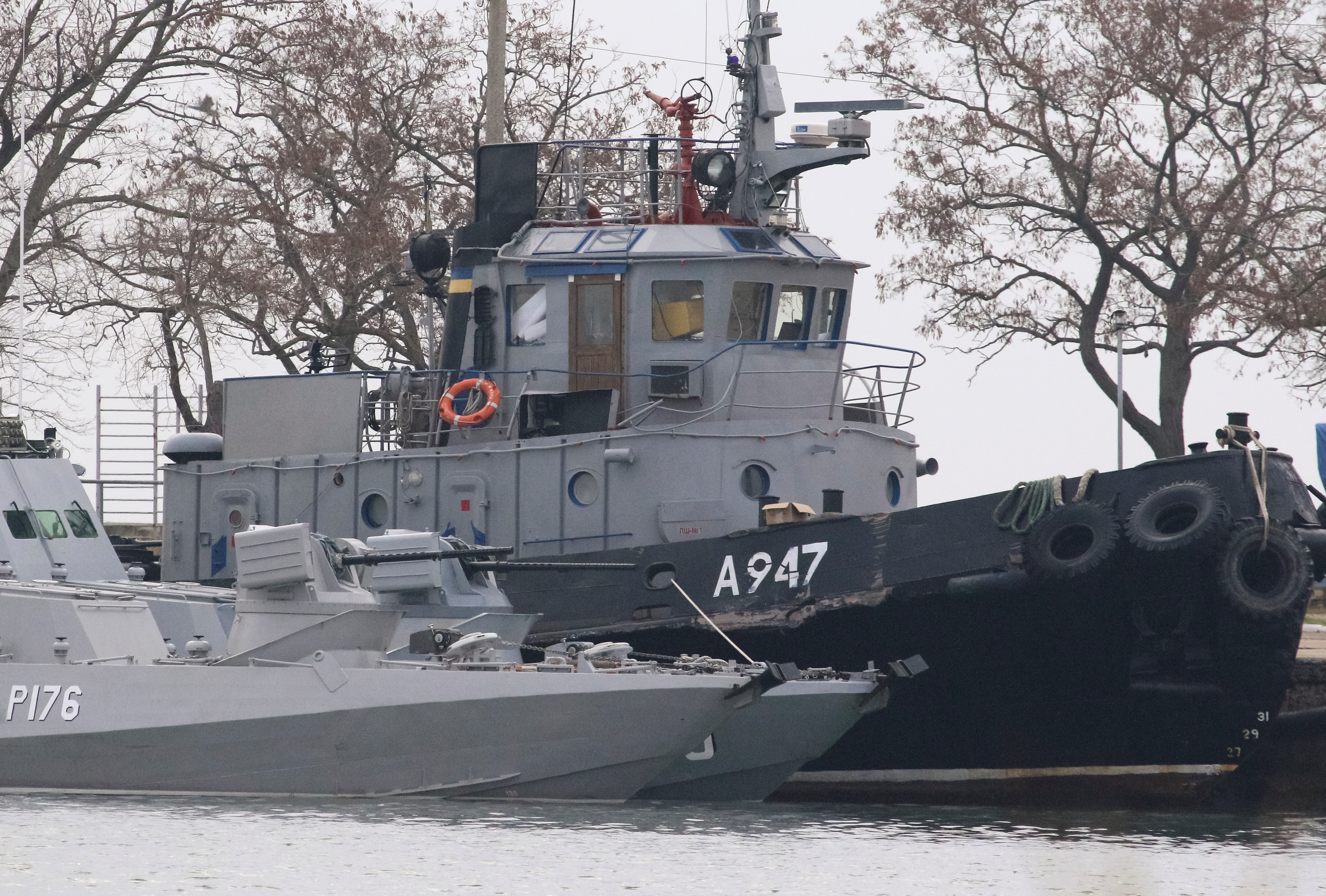 Seized Ukrainian ships, small armored artillery ships and a tug boat, are seen anchored in a port of Kerch, Crimea November 26, 2018.