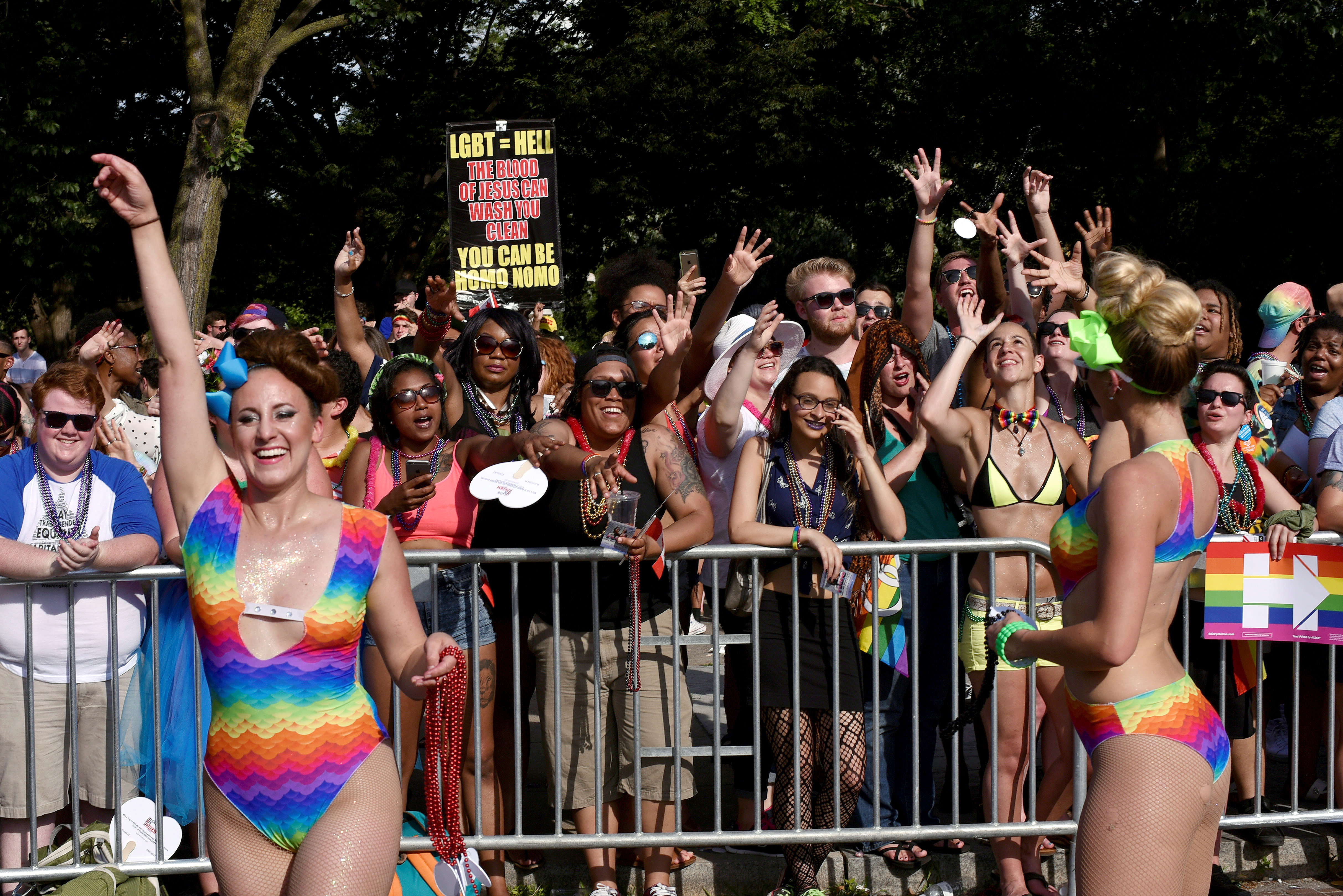 A religious group holds up a sign in protest during the DC Capital Pride parade in the Dupont Circle neighborhood in Washington, June 11, 2016.