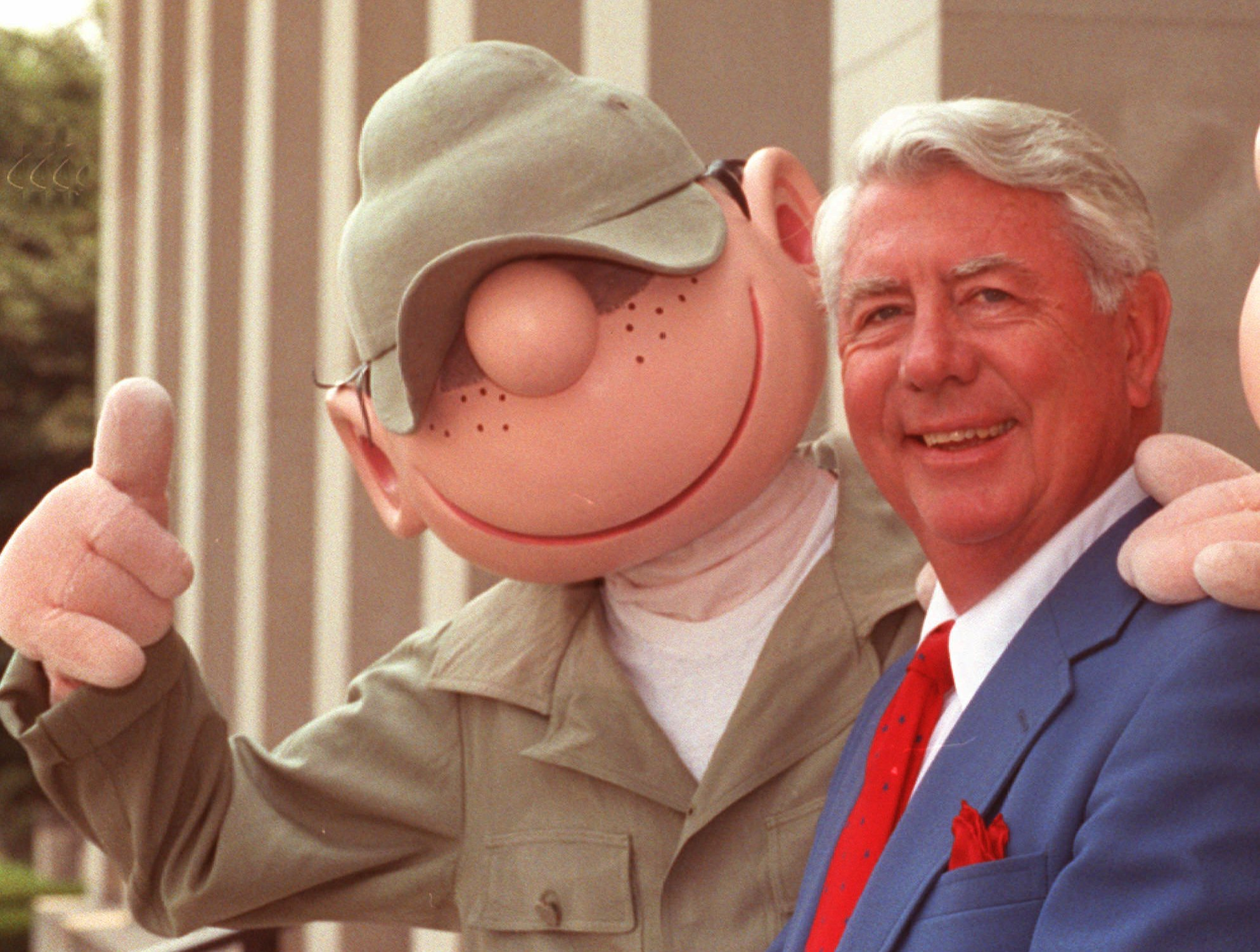 """FILE - Mort Walker, who created the comic strip """"Beetle Bailey"""" in 1950, poses with an actor in """"Beetle"""" costume  at the Pentagon in Washington, June 15, 1990."""