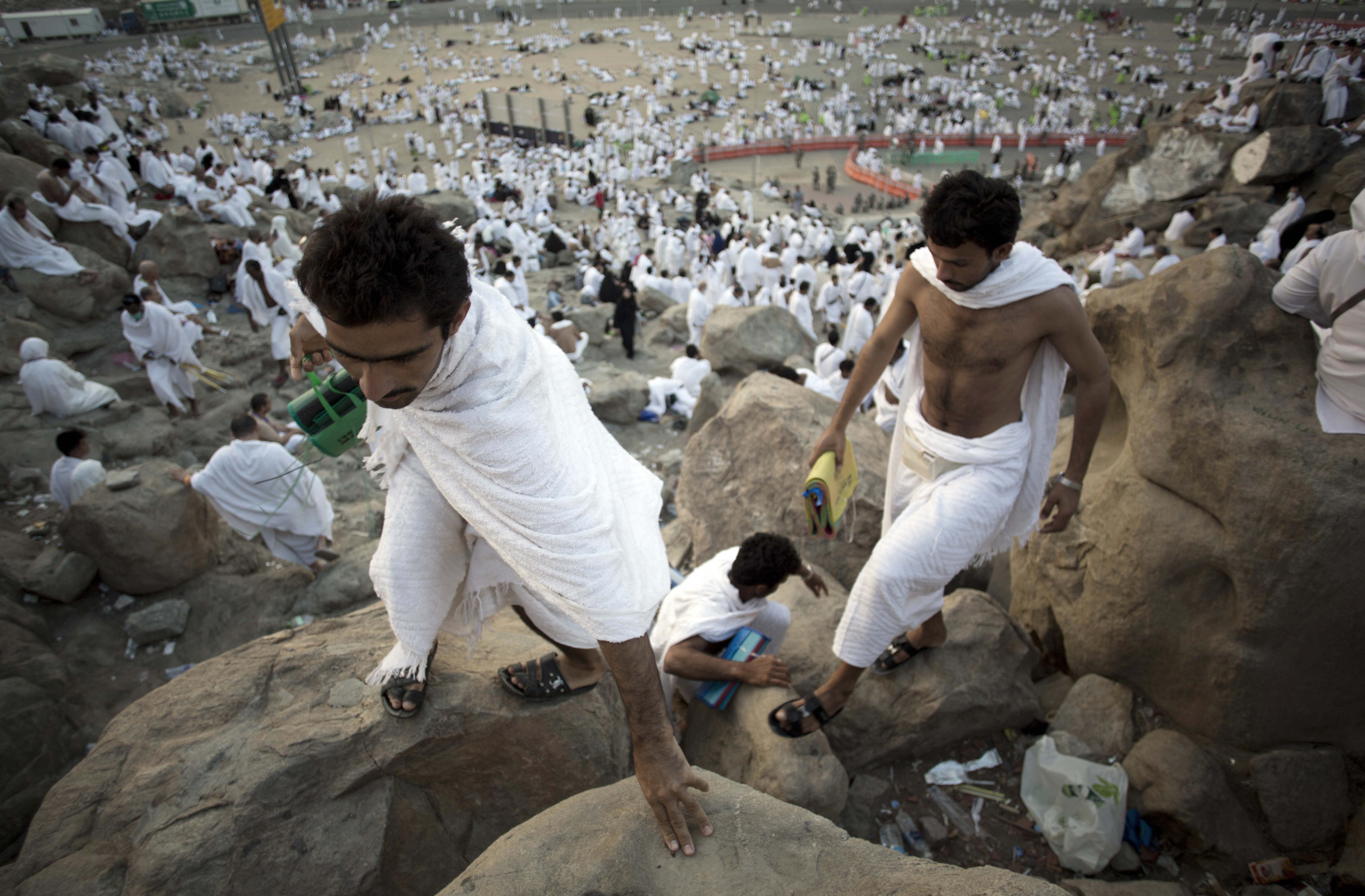 Muslim pilgrims climb Jabal Al Rahma holy mountain, or the mountain of forgiveness, at Arafat for the annual Hajj pilgrimage, outside the holy city of Mecca, Saudi Arabia, Aug. 31, 2017.