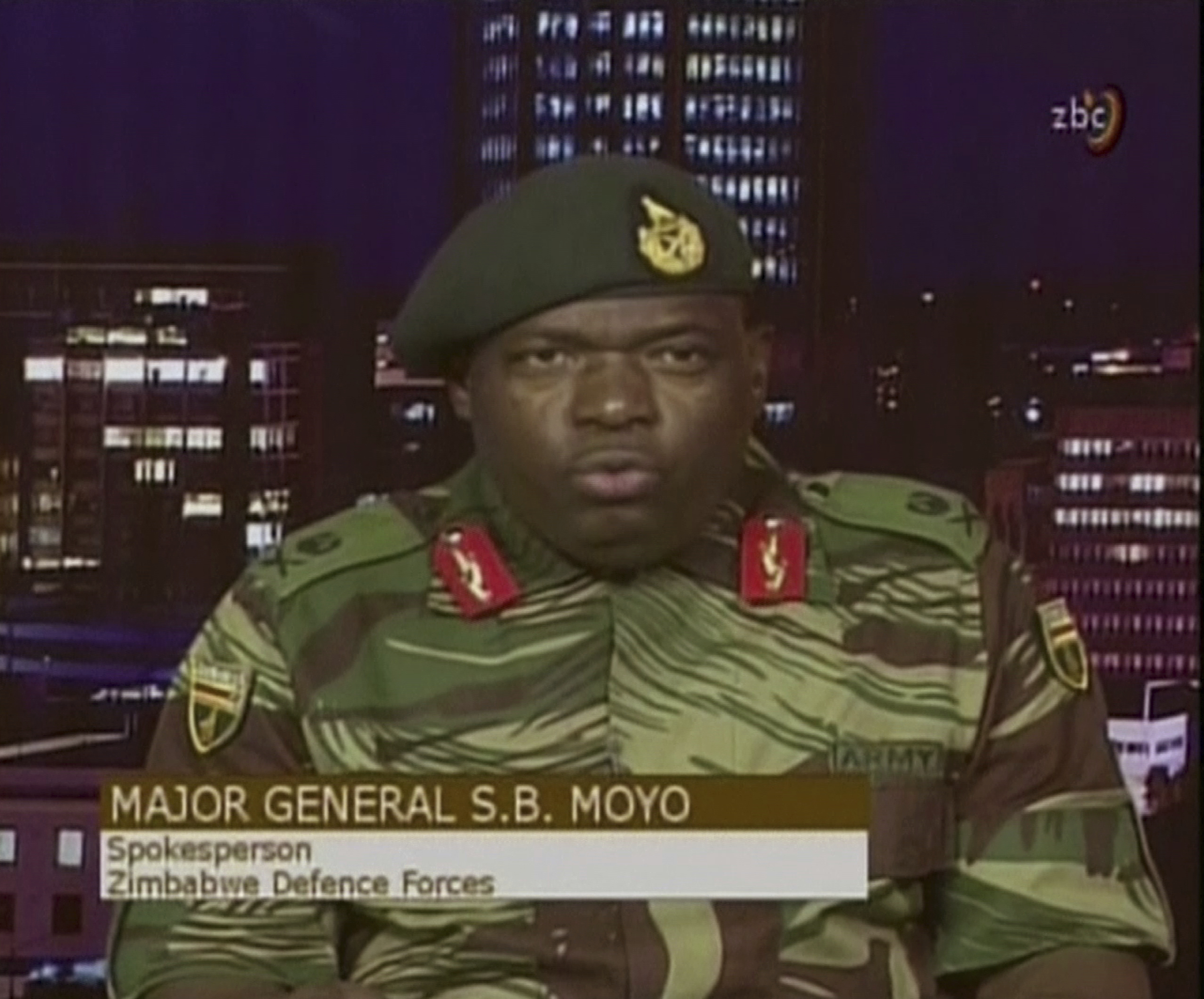 In this image made from video, Major Gen. S.B. Moyo, Spokesperson for the Zimbabwe Defense Forces addresses to the nation in Harare, Zimbabwe, Nov. 15, 2017.