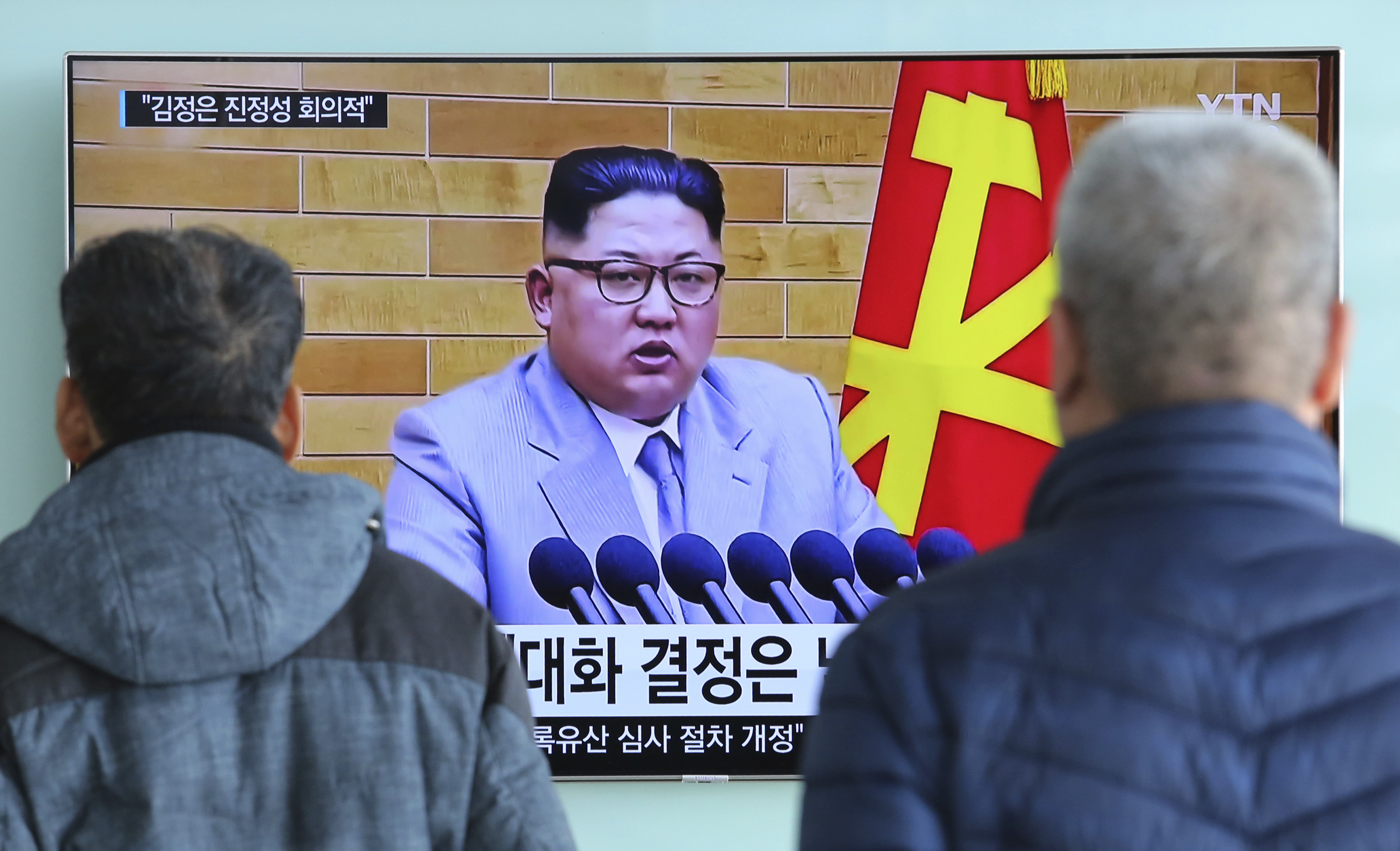 People watch a TV screen showing North Korean leader Kim Jong Un's New Year's speech, at Seoul Railway Station in Seoul, South Korea, Jan. 3, 2018. North and South Korea agreed Friday to revive their formal dialogue.