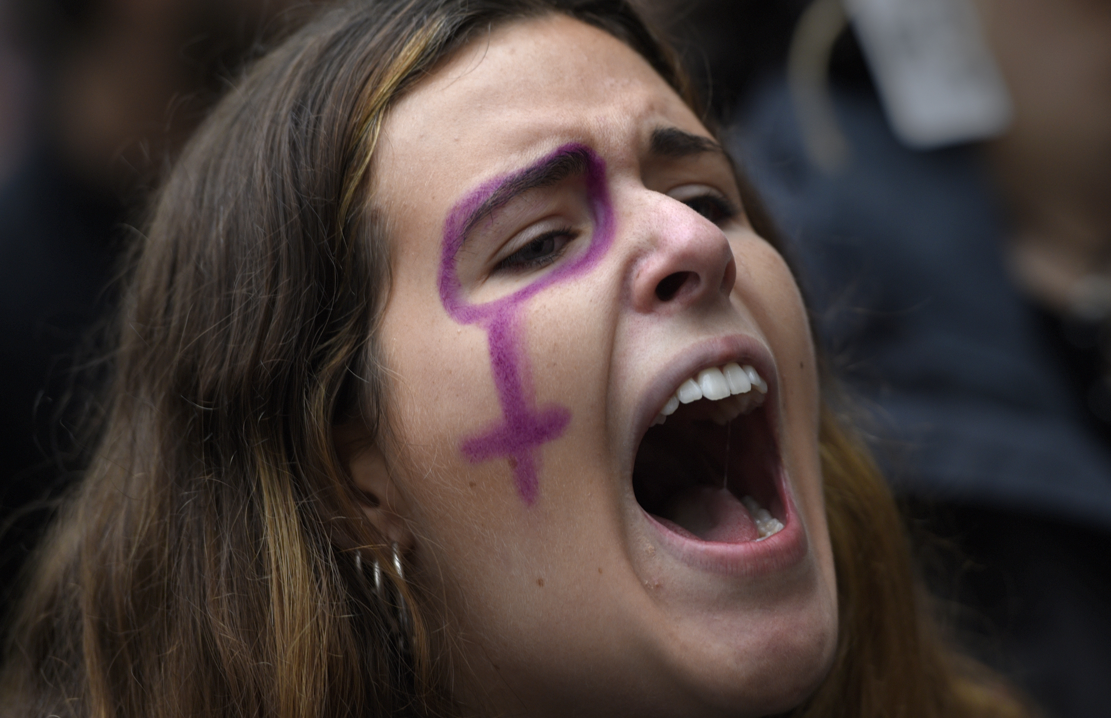 A woman shouts a slogan during the rally on the International Day for the Elimination of Violence against Women in Oviedo, northern Spain, Nov. 25, 2017.