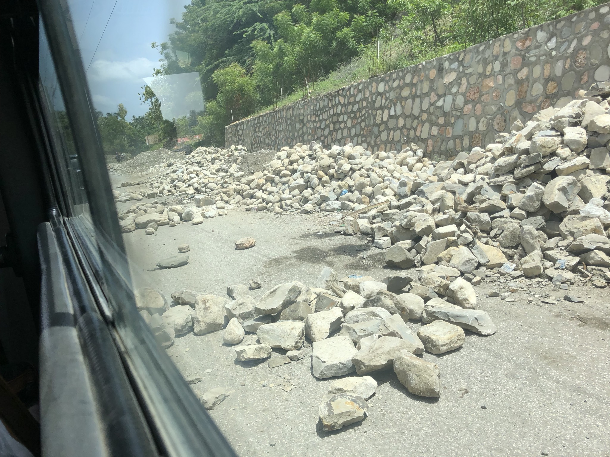 A makeshift roadblock made of rocks on the road to Jacmel
