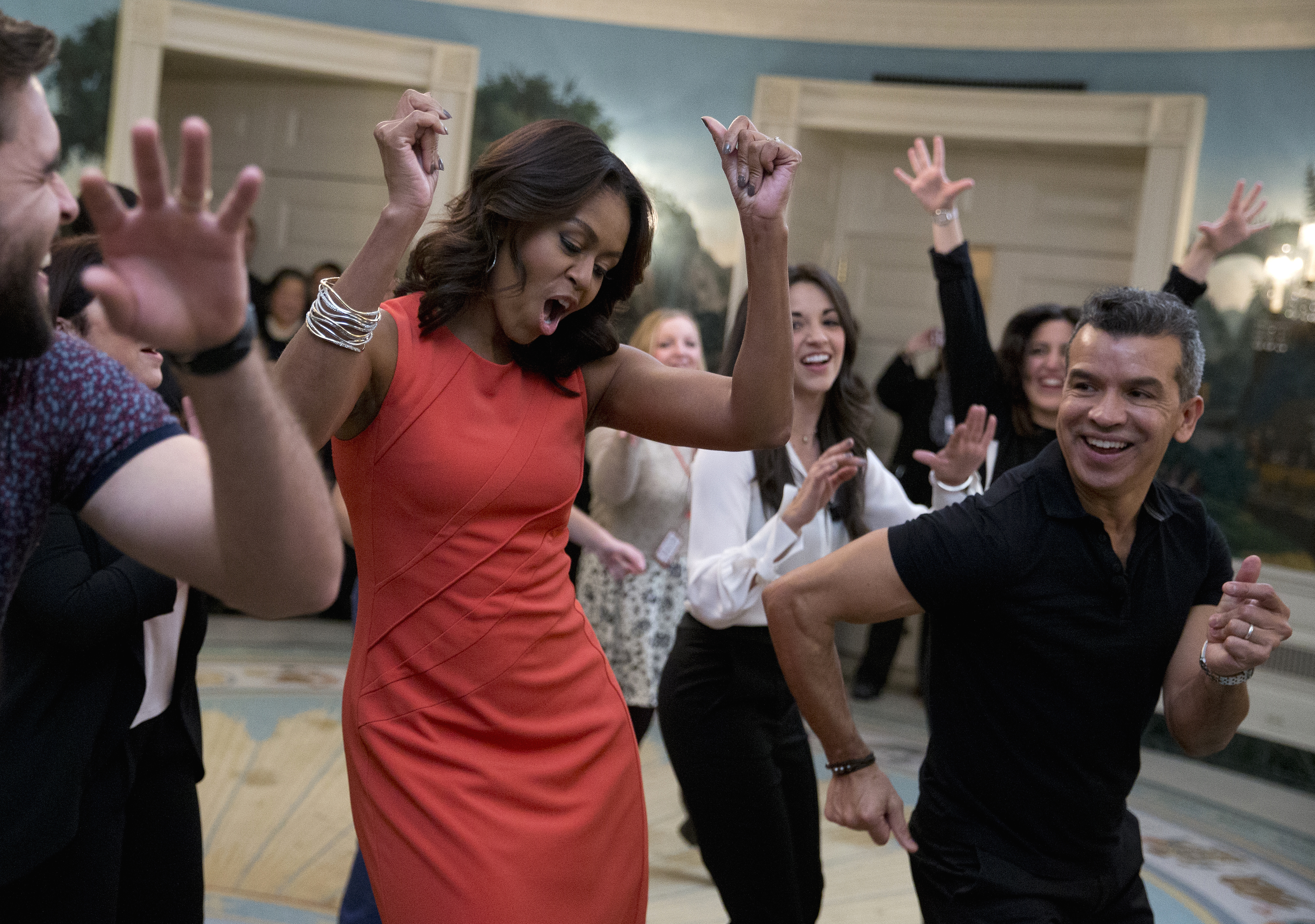 "First lady Michelle Obama dances to Gloria Estefan's ""Conga"" in the Diplomatic Room of the White House in Washington,  Nov. 16, 2015, during a Broadway at the White House event for high school students involved in performing arts programs."
