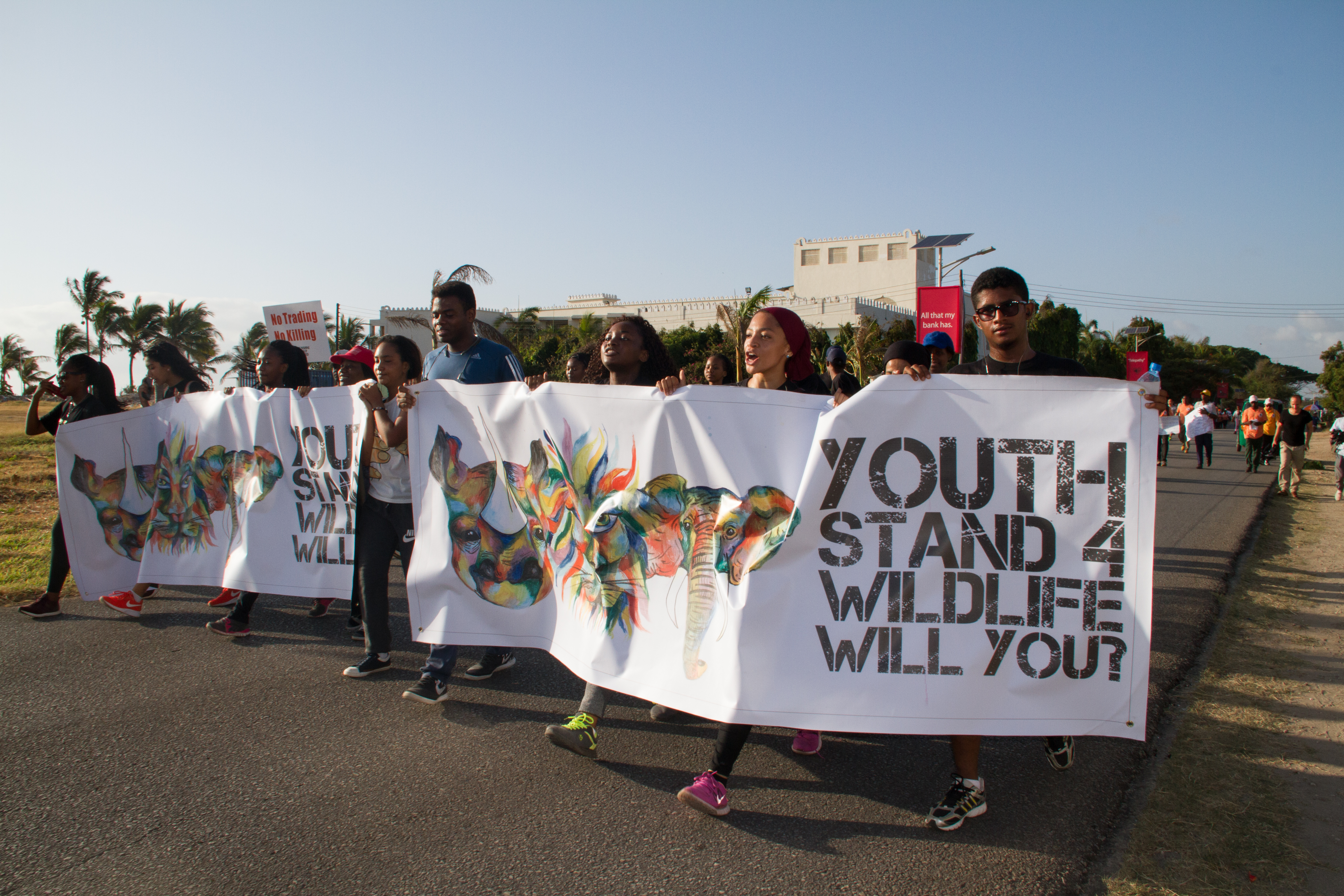 A group of young Tanzanians march in the 'Walk for Elephants' event in Dar es Salaam, Tanzania, Jan. 14, 2017.