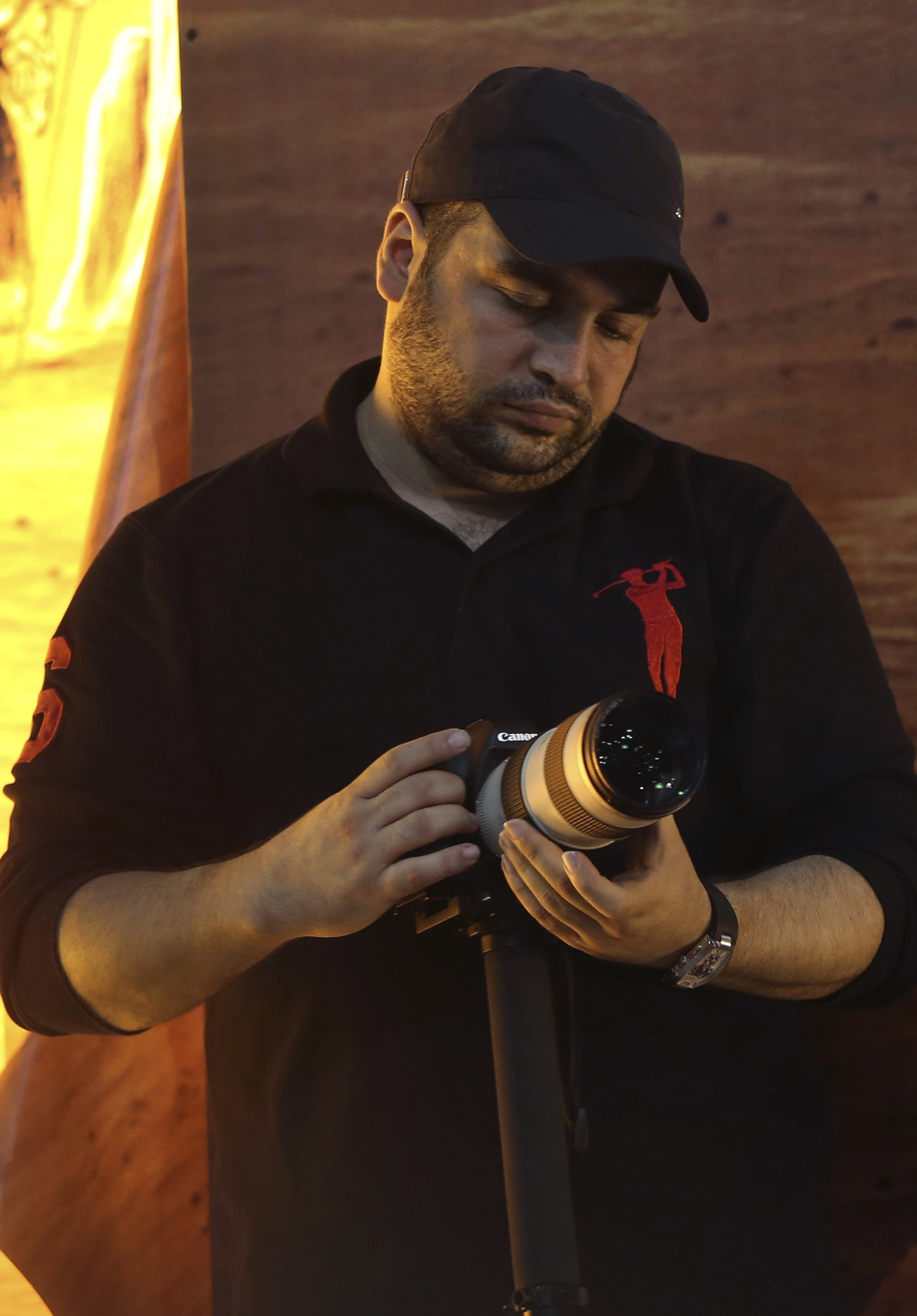 FILE - Jawad Nasrallah, the second-eldest son of Hezbollah leader Sheikh Hassan Nasrallah, adjusts his camera during a speech by his father, in suburban Beirut, Lebanon, Nov. 3, 2014. Jawad has been designated by the U.S. State Department as a global...