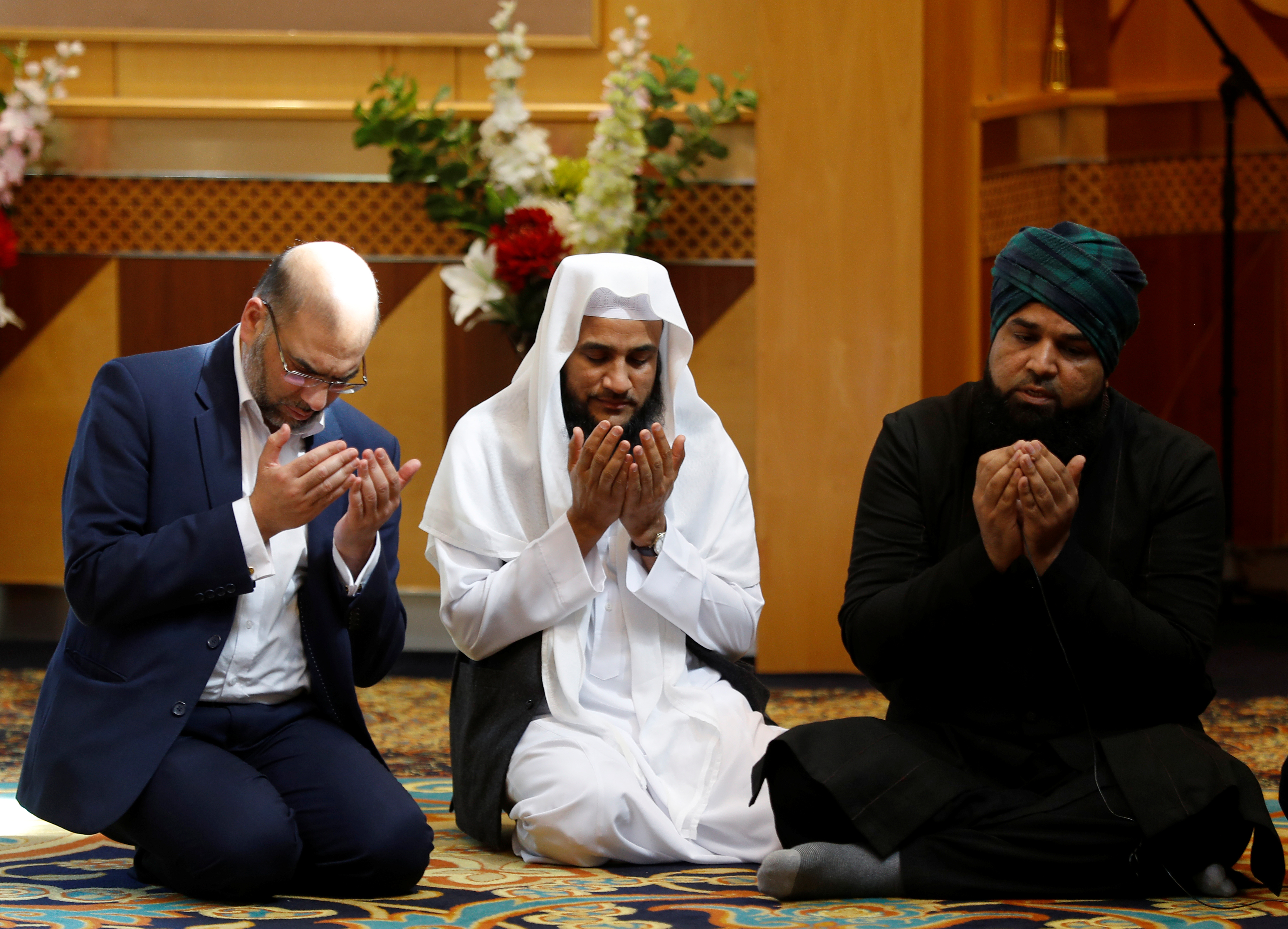 Muslim men pray for victims of the attack at Manchester Arena at a mosque in Manchester, May 23, 2017.