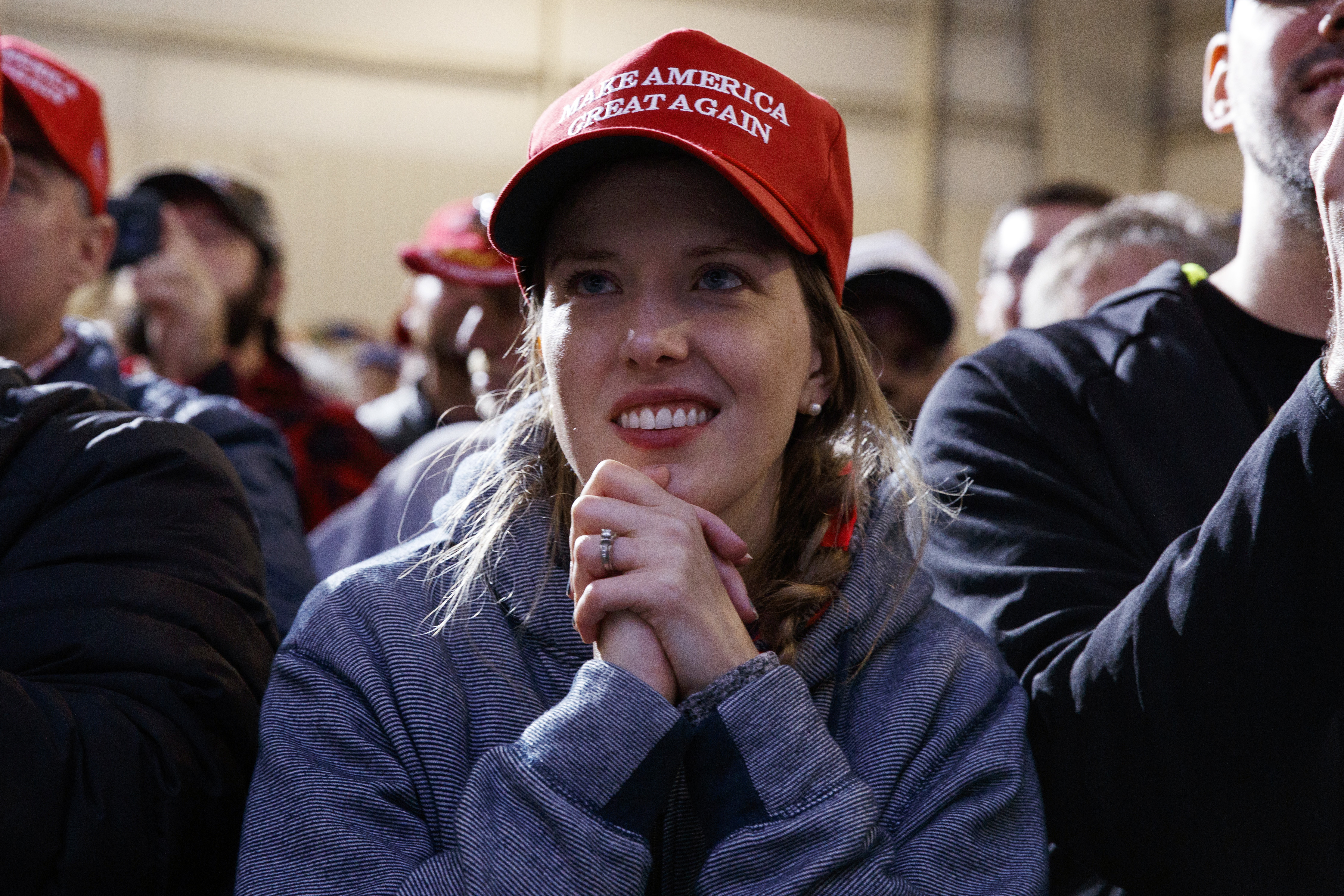 Supporters of President Donald Trump listen to him speak during a campaign rally at Columbia Regional Airport, Nov. 1, 2018, in Columbia, Mo.