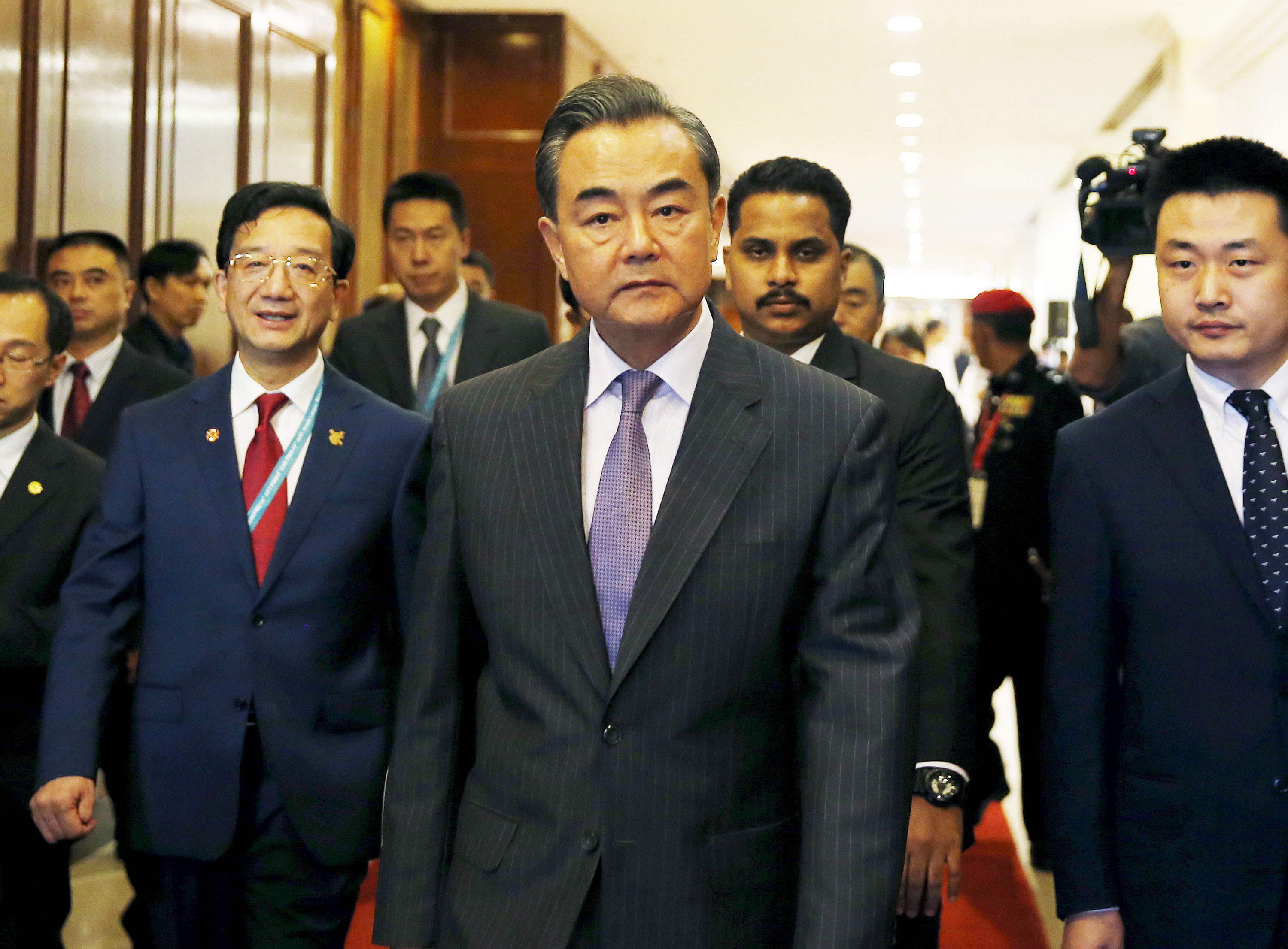 China's Foreign Minister Wang Yi arrives at a meeting during the 48th Association of Southeast Asian Nations (ASEAN) foreign ministers meeting in Kuala Lumpur, Malaysia, Aug. 4, 2015.